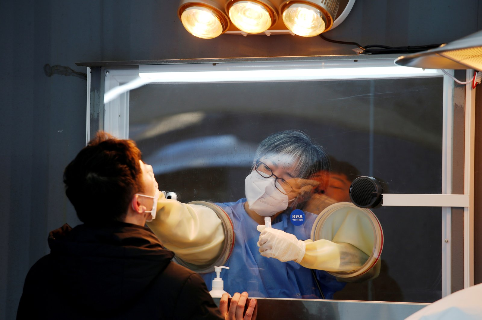 A man undergoes the coronavirus disease (COVID-19) test at a temporary testing site at City Hall Plaza in Seoul, South Korea, Dec. 18, 2020. (REUTERS)