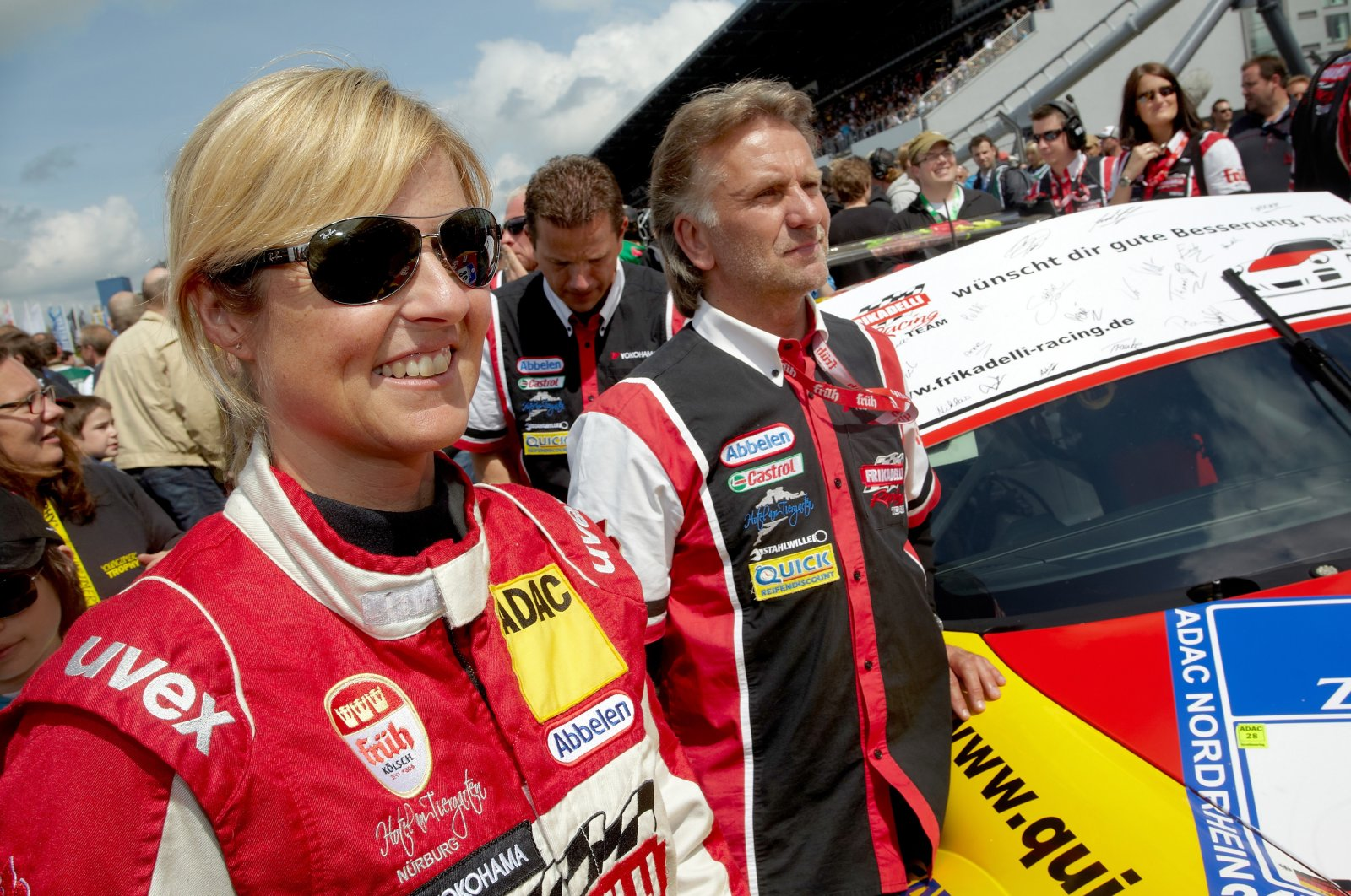German racing driver Sabine Schmitz (L) of Team Frikadelli Racing standing next to her Porsche racing car during the 24-hour car race on the Nuerburgring race track, Germany, May 19, 2011. (EPA Photo)