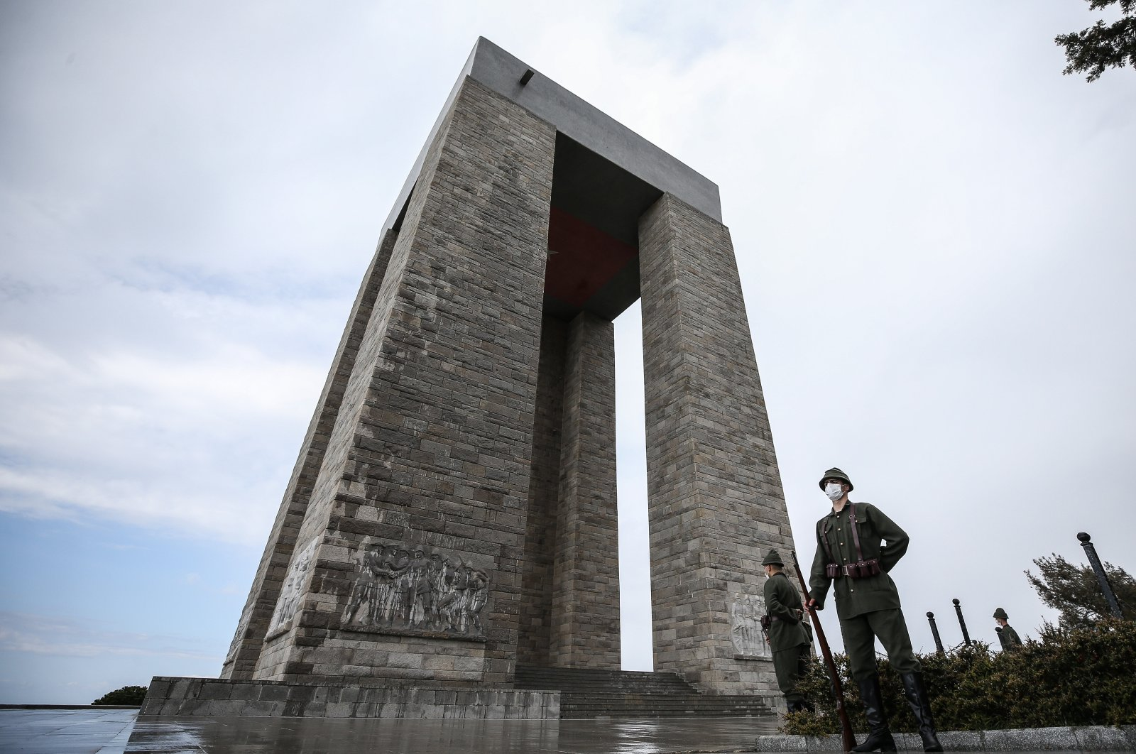 Soldiers dressed in the uniform of those who fought the 1915 battle, stand guard at a monument dedicated to fallen soldiers, in Çanakkale, western Turkey, Mar. 18, 2021. (AA PHOTO)
