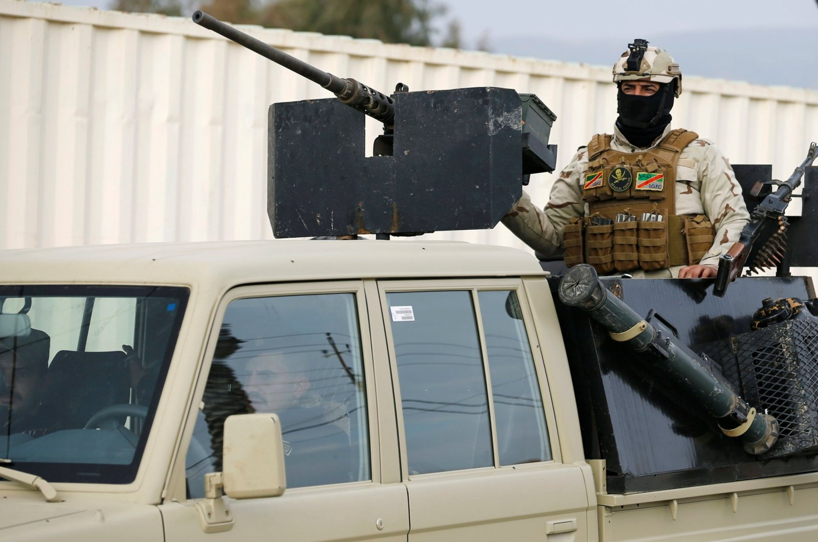A member of Iraqi security forces rides on a military vehicle during deployments in Sinjar, Iraq, Dec. 1, 2020. (REUTERS)