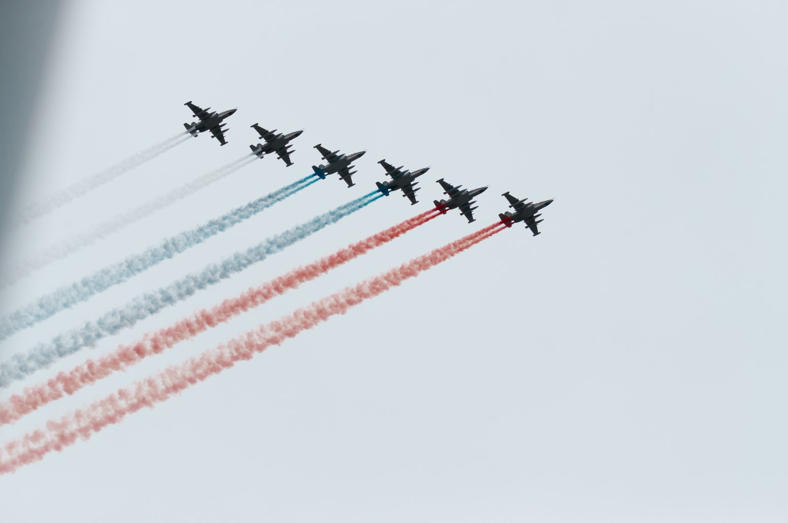 """MiG-29 And SU-30SM fighters of the """"Russian KNIGHTS"""" and """"SWIFTS"""" aerobatic teams fly over the Kremlin and red square, Moscow, Russia, May 9, 2020. (Shutterstock Photo)"""