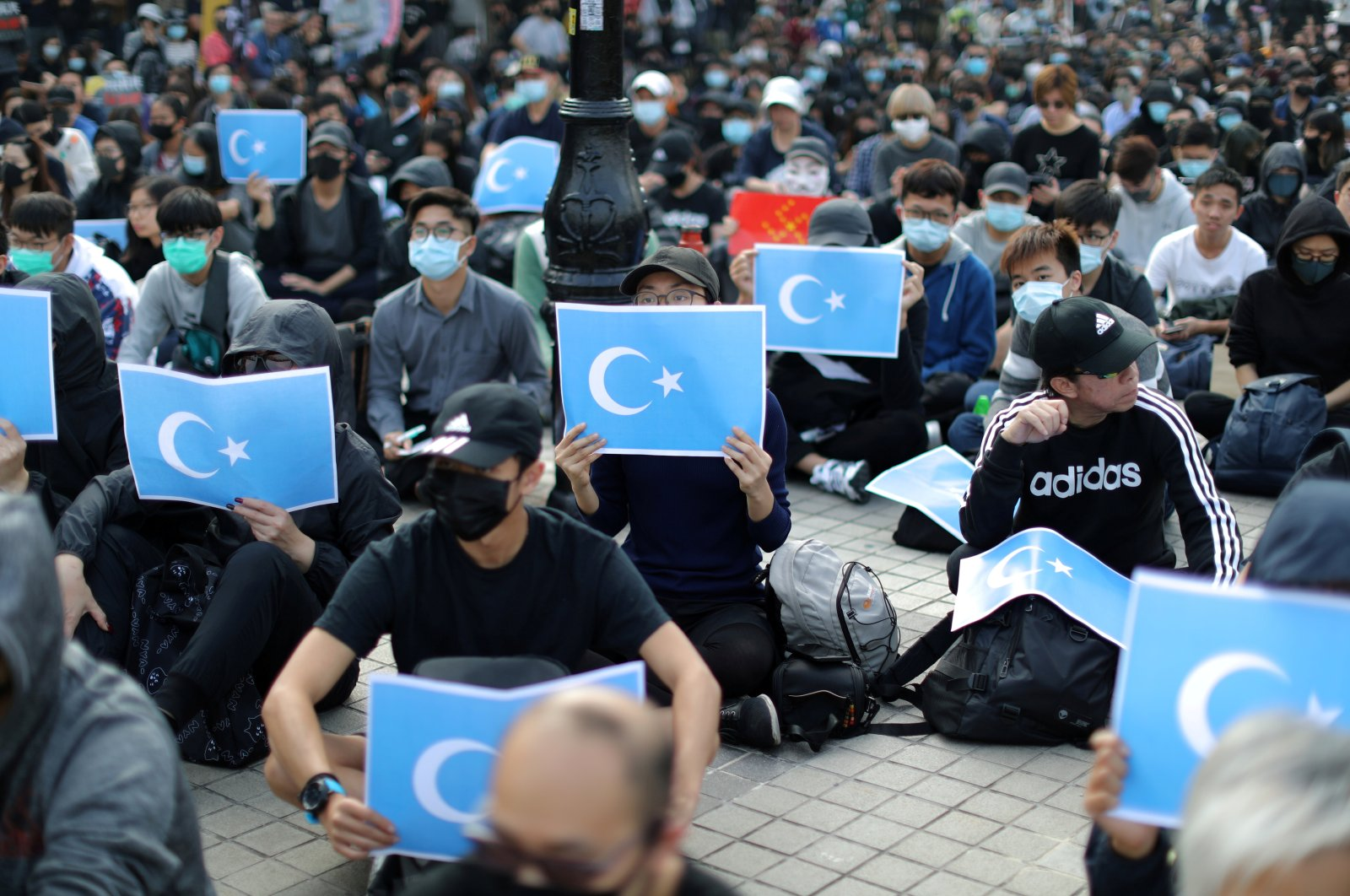 Hong Kong protesters hold East Turkestan Uyghur flags at a rally in support of Xinjiang Uyghurs' human rights in Hong Kong, China, Dec. 22, 2019. (REUTERS)