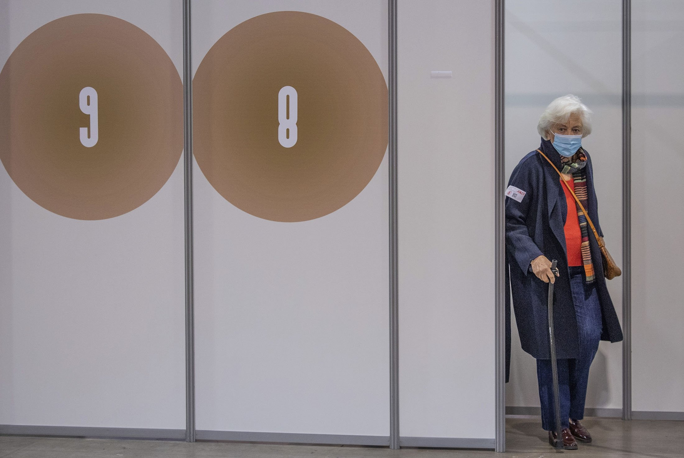 Belgium's Queen Paola leaves the vaccination cubicle after receiving her COVID-19 vaccination at the Brussels Expo vaccine center in Brussels, March 18, 2021. (AP Photo)