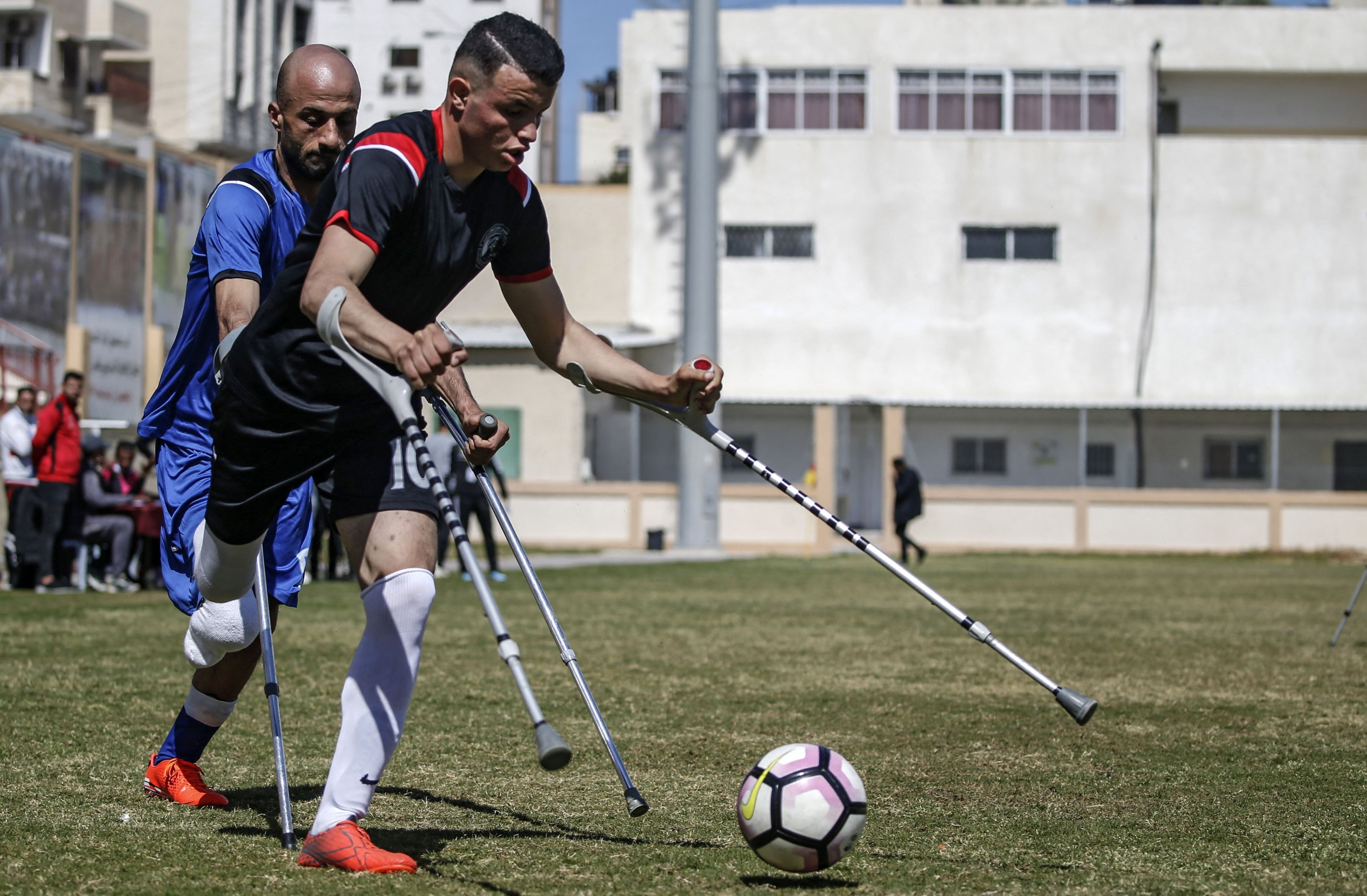 Palestinian players compete during the final of a local football championship for amputees, organized by the International Committee of the Red Cross (ICRC), in Gaza City, March 18, 2021. (AFP Photo)