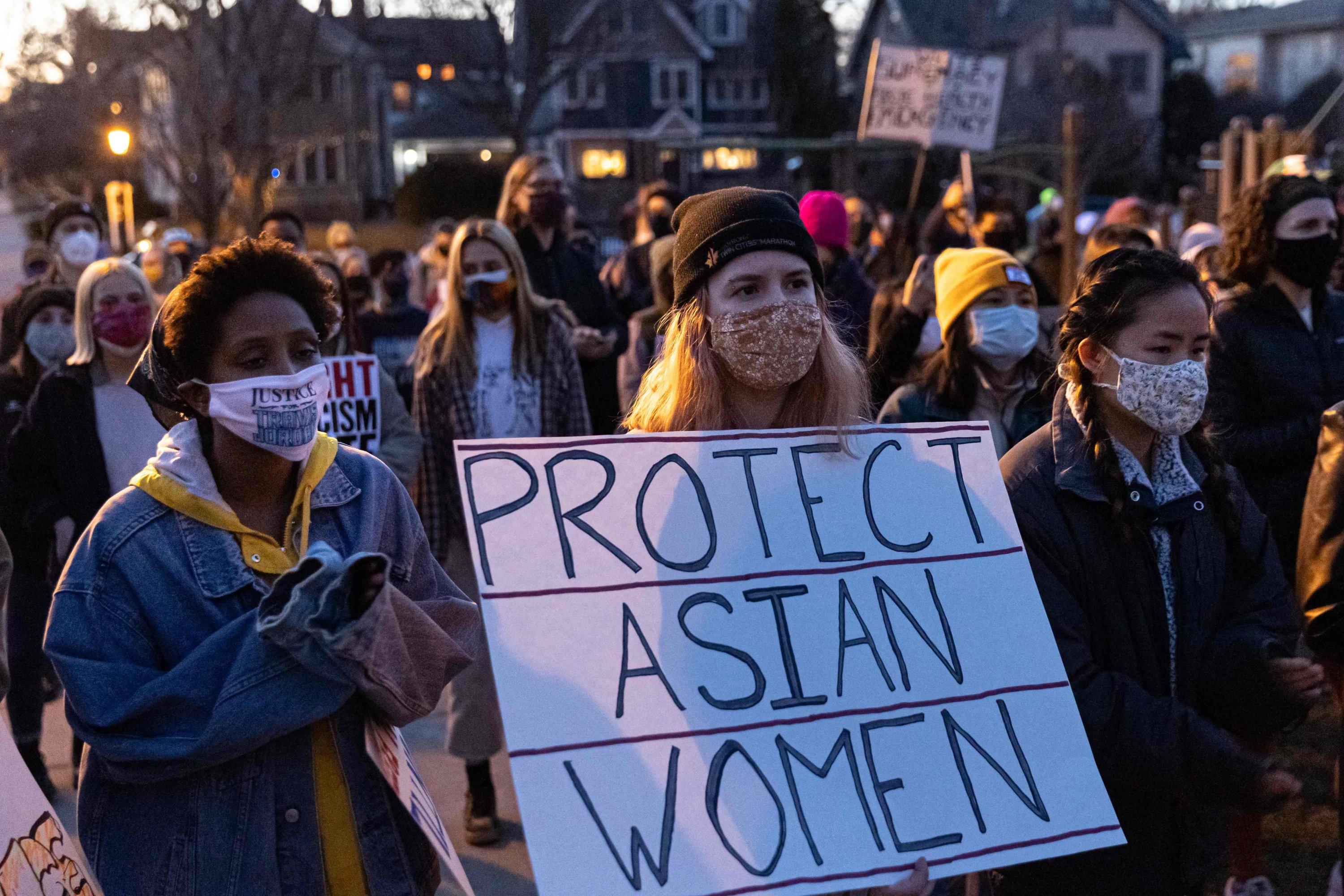 A woman holds a sign during the Asian Solidarity March rally against anti-Asian hate in response to recent anti-Asian crime, Minneapolis, Minnesota, March 18, 2021. (AFP Photo)