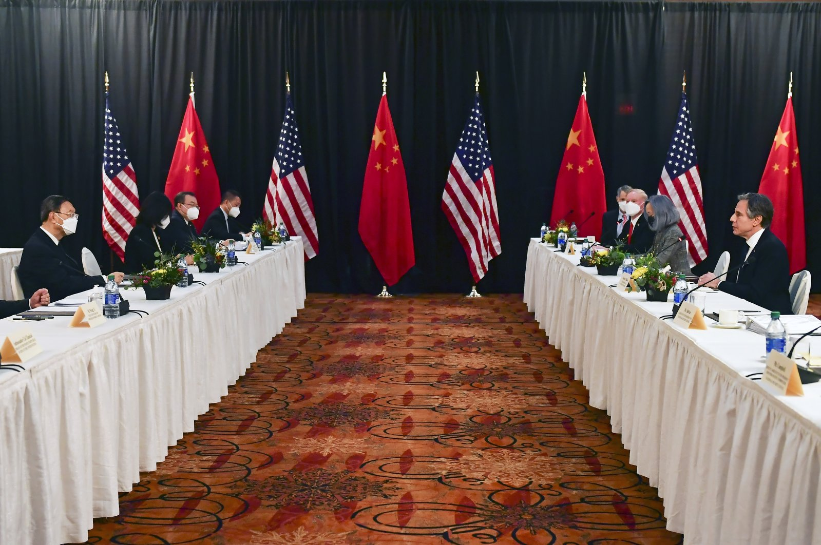 China's State Councilor Wang Yi (L) and Chinese Communist Party foreign affairs chief Yang Jiechi (2nd from L) listen as Secretary of State Antony Blinken (2nd from R) speaks while sitting next to National Security Adviser Jake Sullivan (R) during the opening session of US-China talks at the Captain Cook Hotel in Anchorage, Alaska, March 18, 2021. (AP Photo)