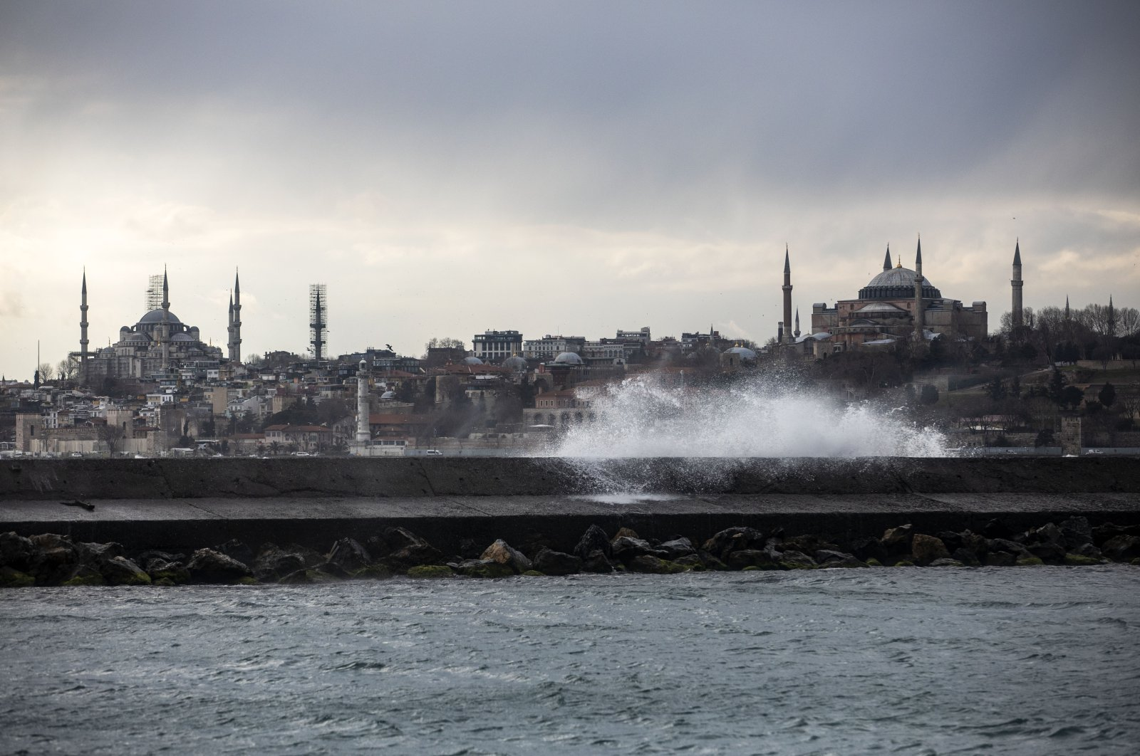 A sea wave hits a breakwater amid strong winds, with the Blue Mosque (L) and the Hagia Sophia Grand Mosque (R) seen in the background, at the Bosporus, Istanbul, Turkey, March 16, 2021. (Photo by Getty Images)