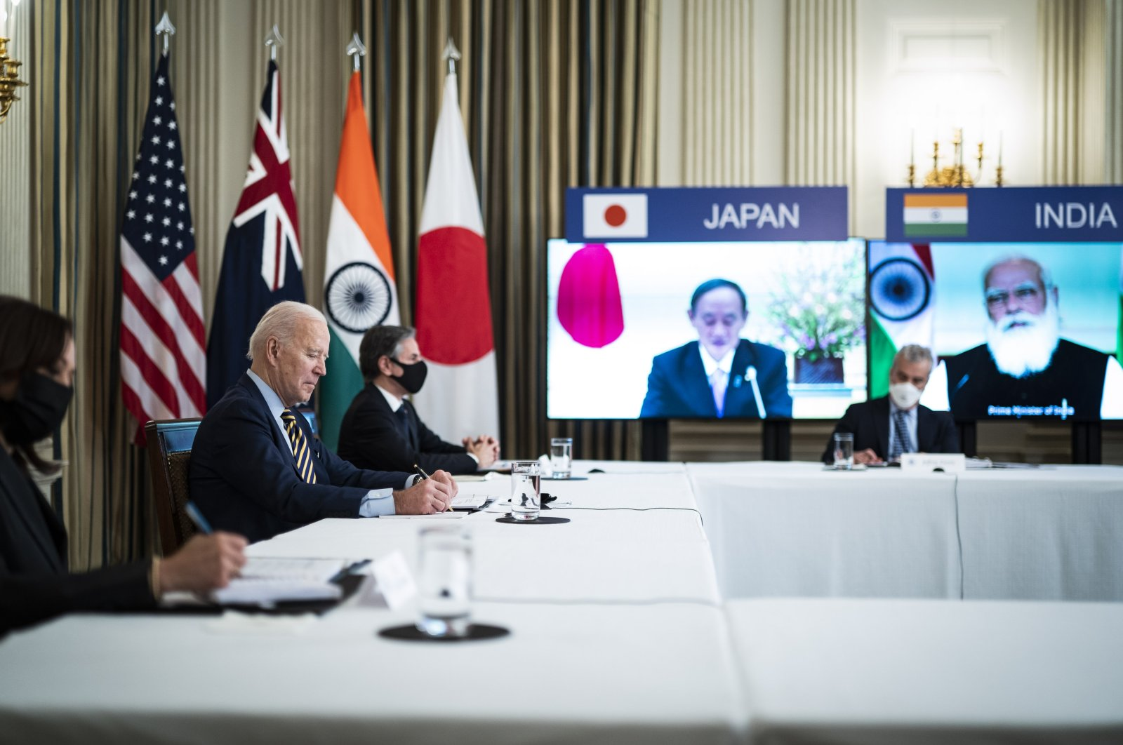U.S. President Joe Biden and his delegation attend the virtual summit of the Quadrilateral Security Dialogue (Quad) with Japanese Prime Minister Yoshihide Suga, Indian Prime Minister Narendra Modi and Australian Prime Minister Scott Morrison,at the White House, Washington, D.C., U.S.,March 12, 2021.(Photo by Getty Images)