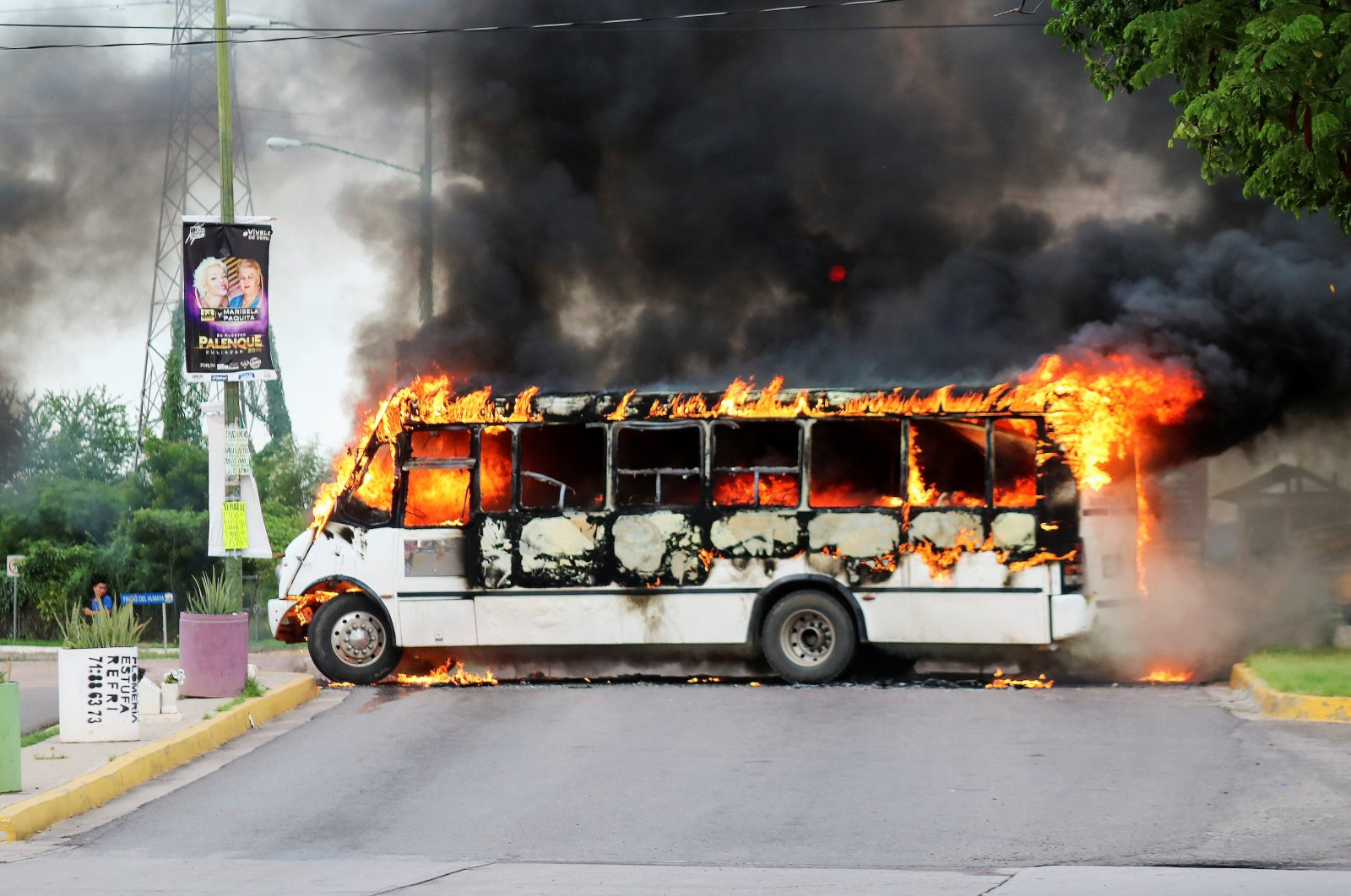 """A burning bus, set alight by cartel gunmen to block a road, is pictured during clashes with federal forces following the detention of Ovidio Guzman, son of drug kingpin Joaquin """"El Chapo"""" Guzman Culiacan, Sinaloa state, Mexico, Oct. 17, 2019. (Reuters Photo)"""