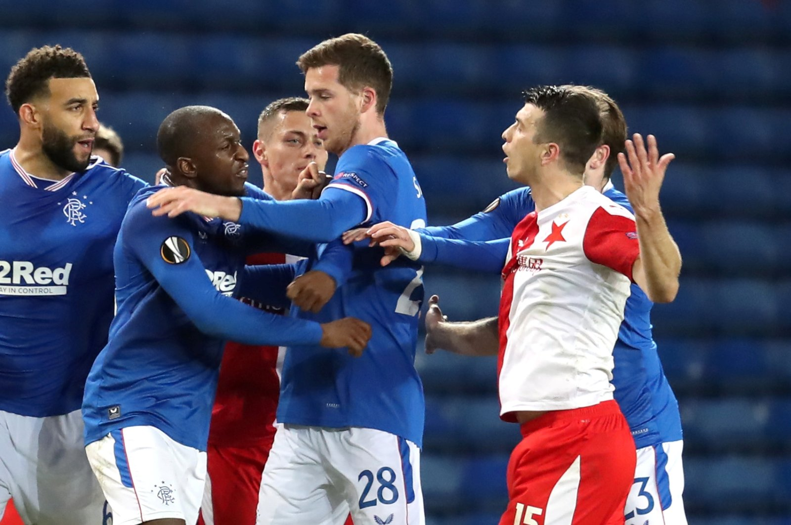 Slavia Prague's Ondrej Kudela (R) clashes with Rangers' Glen Kamara (2nd L) during a Europa League round of 16, second leg match at Ibrox Stadium, Glasgow, Scotland, March 18, 2021. (Reuters Photo)