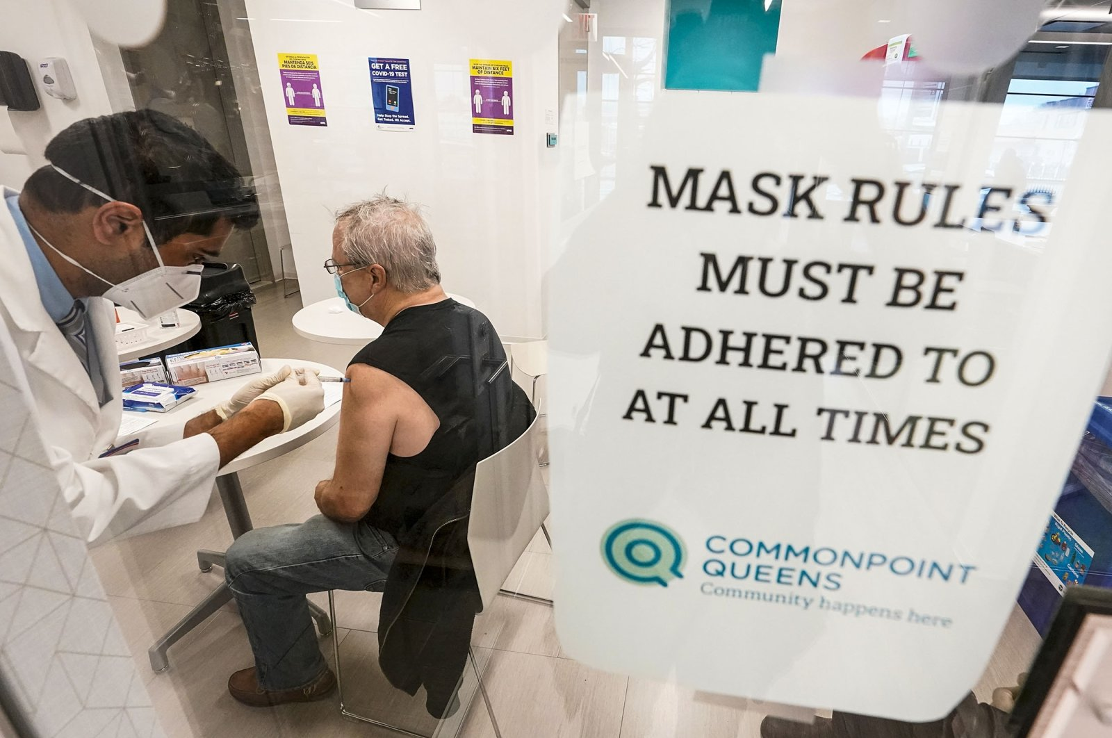 Pharmacist Ambar Keluskar inoculates a patient with the first dose of the Moderna COVID-19 vaccine at a pop-up site on March 18, 2021, in New York. (AP Photo)