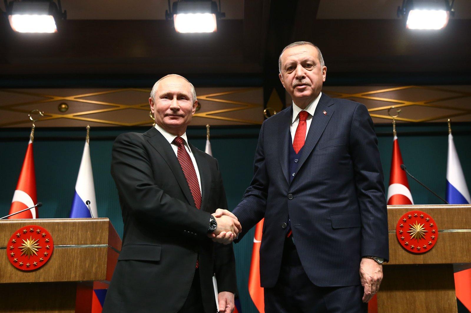 President Recep Tayyip Erdoğan shakes hands with Russian President Vladimir Putin in Ankara, Turkey, April 3, 2018. (Courtesy of Turkish Presidency)