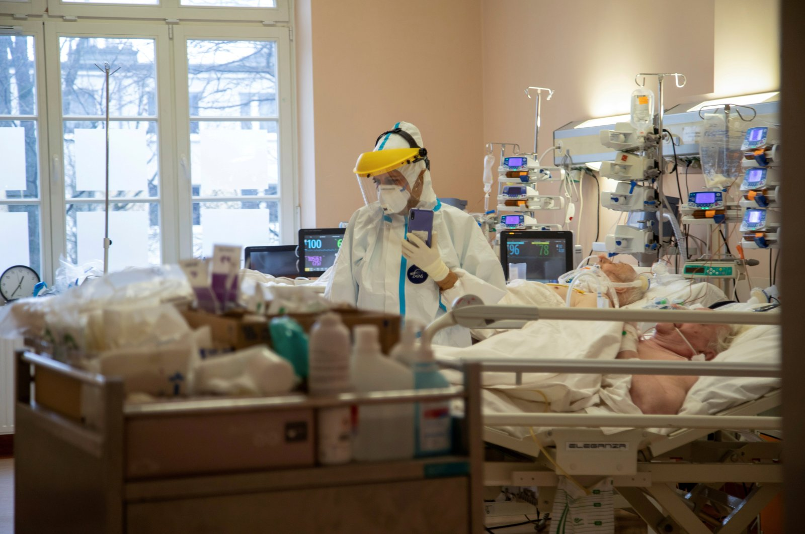 A medical worker attends to patients inside the coronavirus disease (COVID-19) ward at the University Clinical Hospital in Olsztyn, Poland, March 2, 2021. (REUTERS)