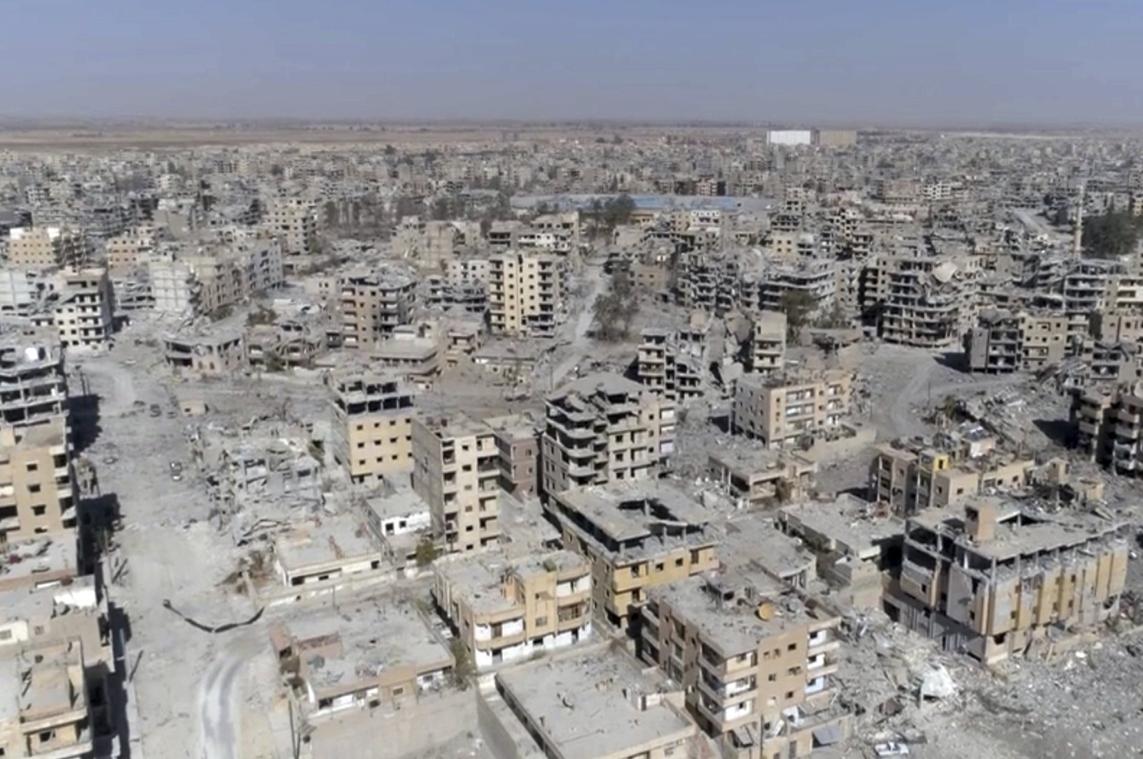 A screengrab from drone video shows damaged buildings in Raqqa, Syria, Oct. 19, 2017. (AP Photo)