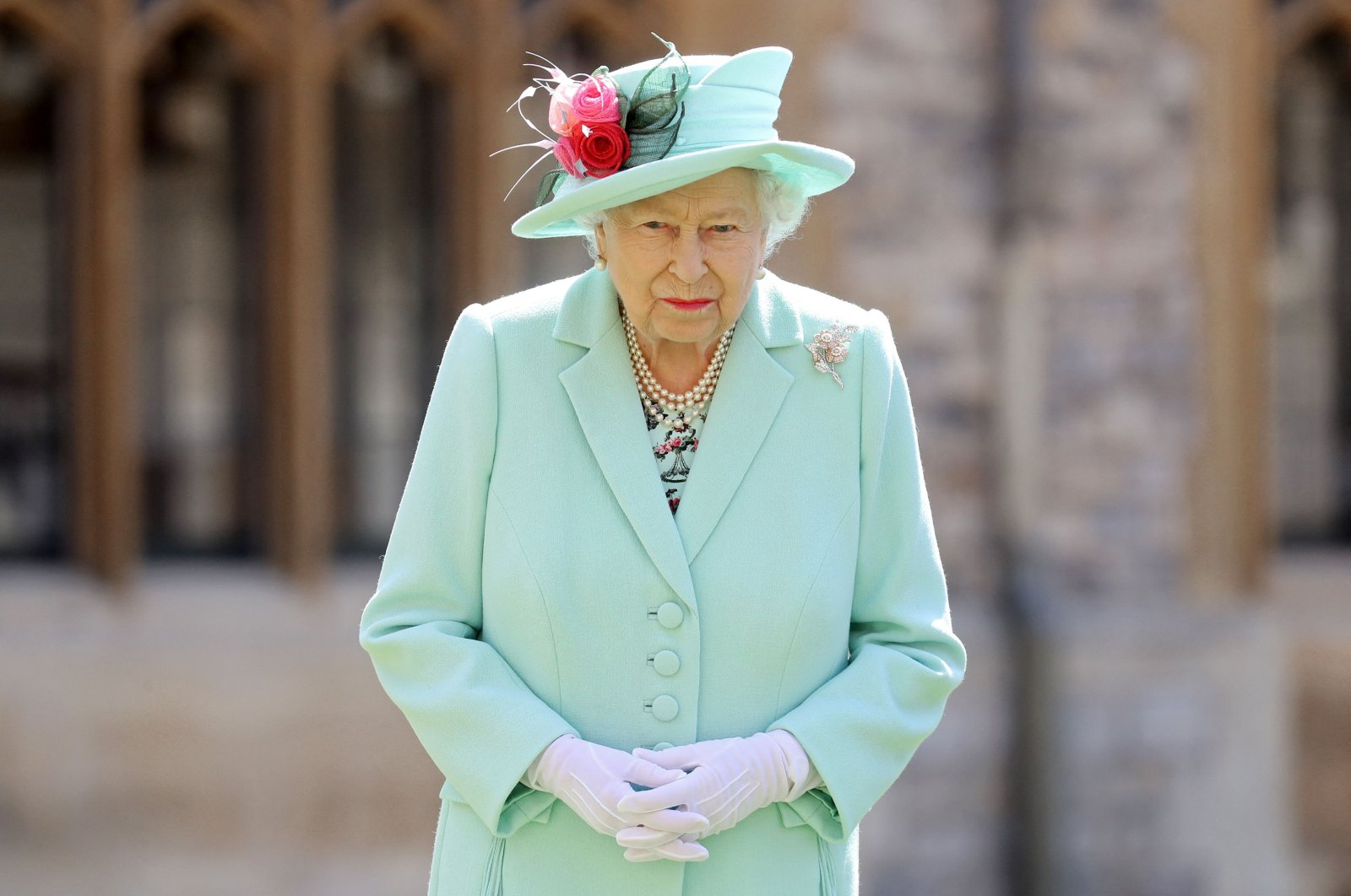 Britain's Queen Elizabeth II poses after conferring the honor of a knighthood upon 100-year-old veteran Captain Tom Moore during an investiture at Windsor Castle in Windsor, London, U.K., July 17, 2020. (AFP File Photo)