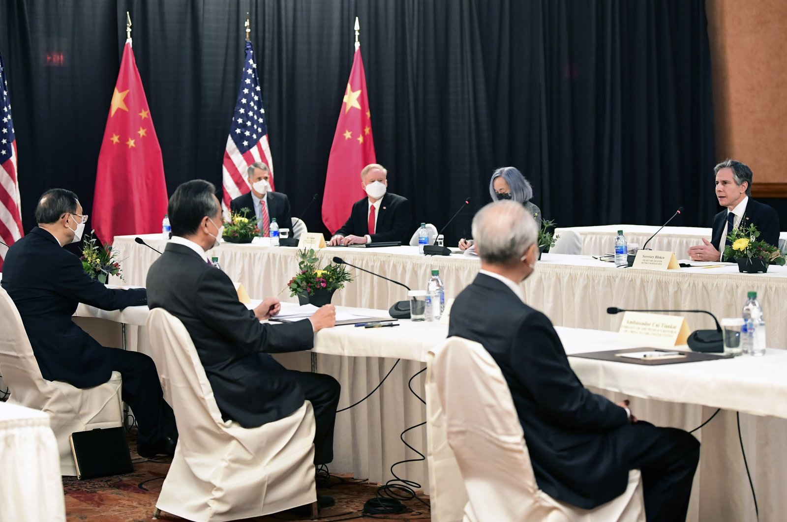Secretary of State Antony Blinken, speaks as Chinese Communist Party foreign affairs chief Yang Jiechi, left, and China's State Councilor Wang Yi, second from left, listen at the opening session of U.S.-China talks at the Captain Cook Hotel in Anchorage, Alaska, Thursday, March 18, 2021. (AP Photo)