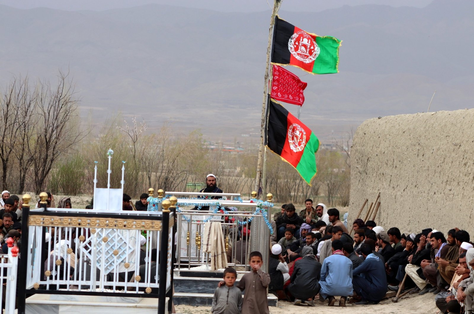 People attend the funeral of Afghan soldier Sherullah Gardezi, one of nine soldiers who died in a military helicopter crash in Maidan-Wardak province, in Paktia, Afghanistan, March 19, 2021. (EPA Photo)