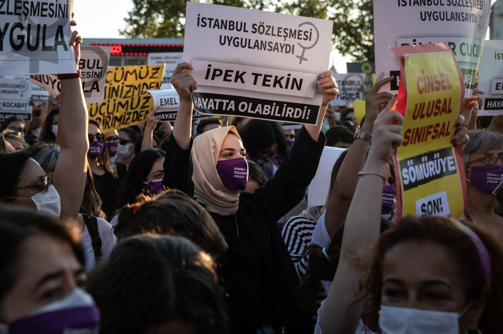 """A woman holds a sign that reads """"İpek Tekin could have been alive if Istanbul Convention was implemented"""" during a women's rights protest in Istanbul, Turkey, Aug. 5, 2020. (Getty Images)"""