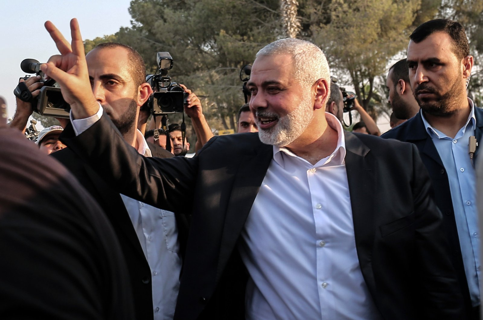 Hamas political chief Ismail Haniyeh flashes the victory gesture upon his arrival on the Palestinian side of the Rafah Border Crossing, in the southern Gaza Strip on Sept. 19, 2017. (AFP File Photo)