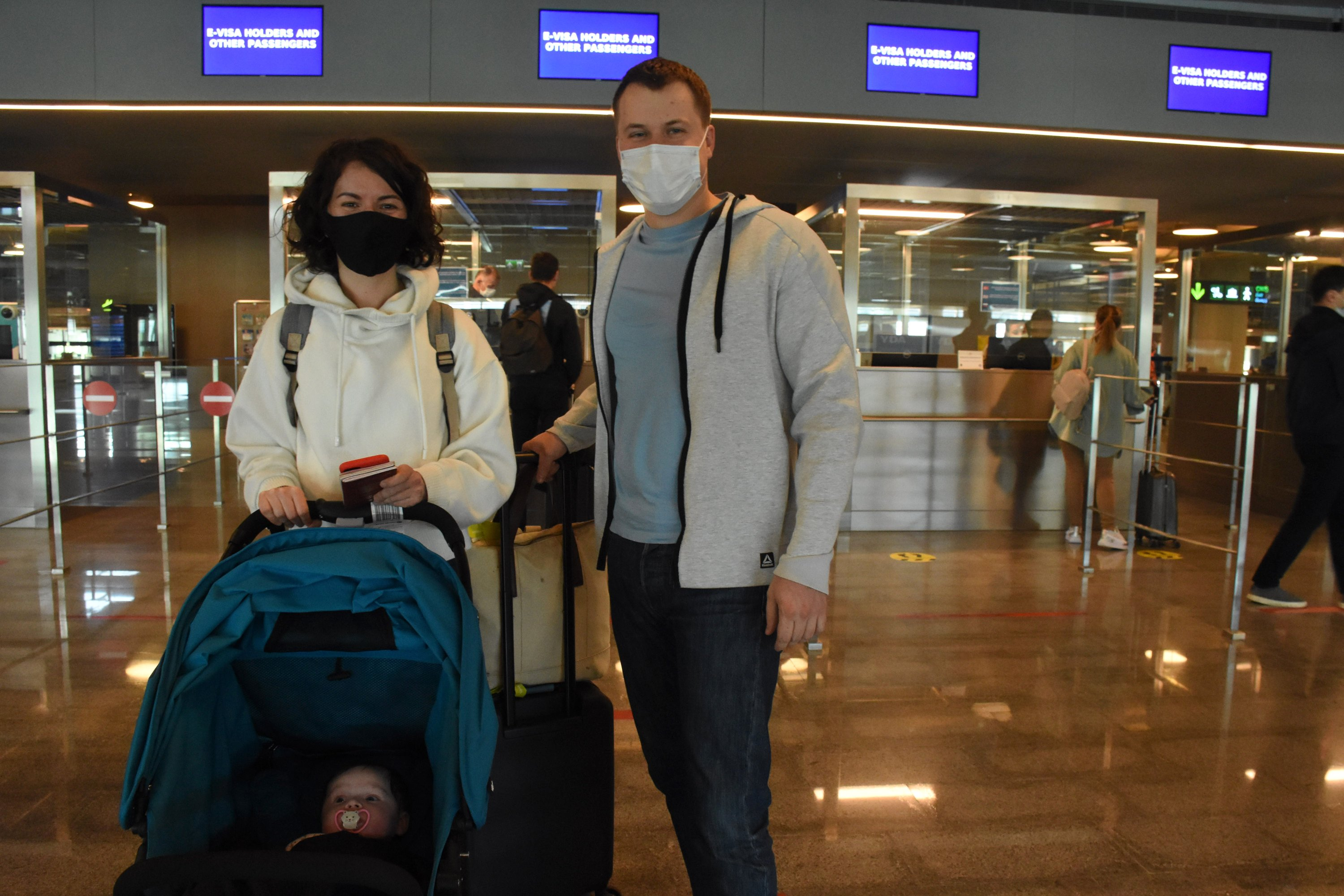 Anastasia Cherkassenka and her husband Denis Cherkassenko arrive at Dalaman Airport, Muğla, southwestern Turkey, March 19, 2021. (AA Photo)