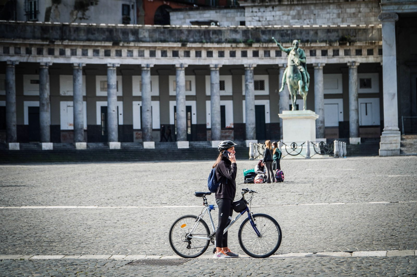 People walk on the streets and squares of the semi-deserted center of Naples, Italy, March 6, 2021. (EPA Photo)