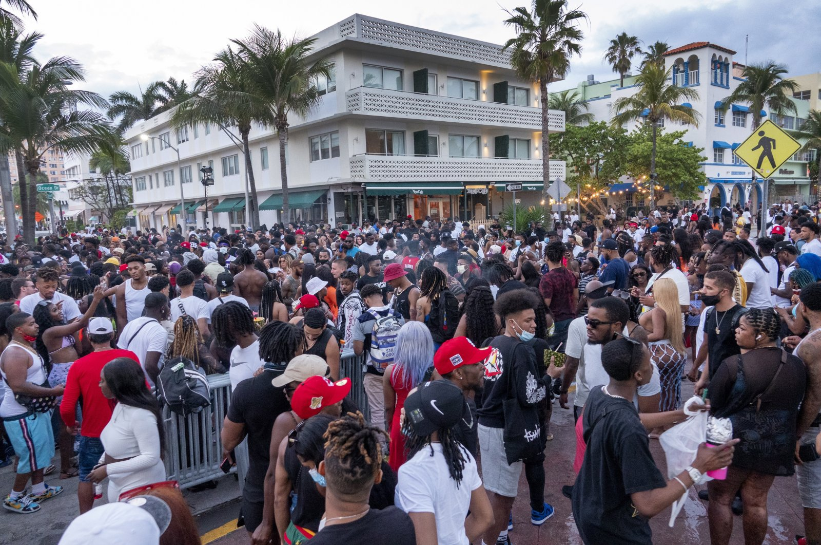 A large crowd of people participate in a party on a walkway near the beach, during spring break in Miami Beach, Fla., U.S., March 20, 2021. (EPA Photo)