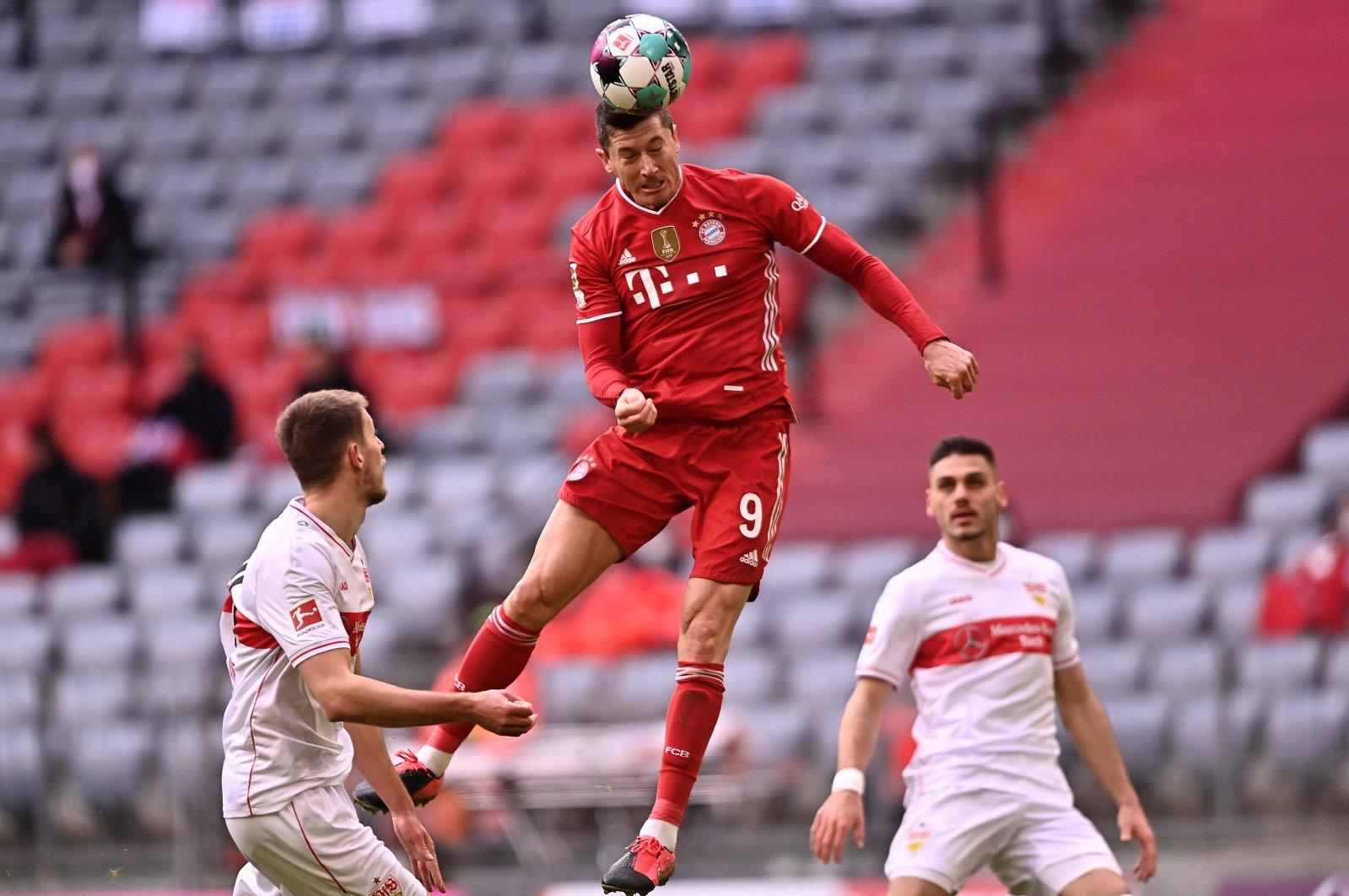 Bayern forward Robert Lewandowski (C) scores a goal against VfB Stuttgart in a Bundesliga match in Munich, Germany, March 20, 2021. (EPA Photos)