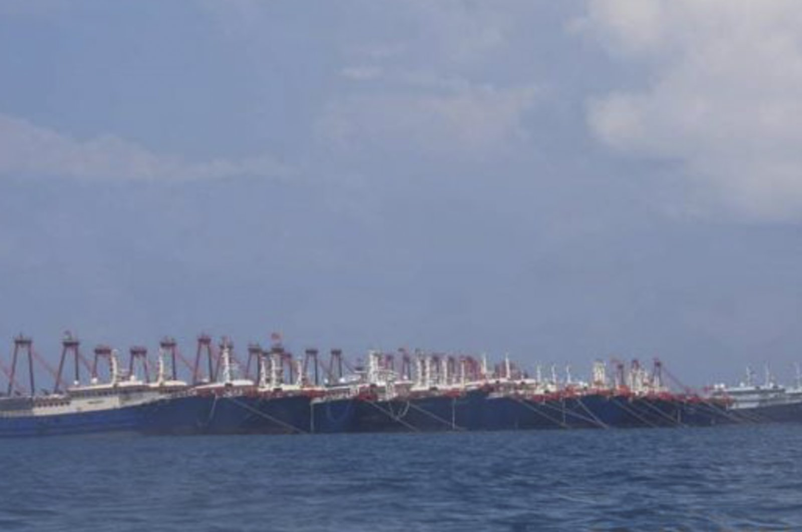 Some of the 220 Chinese vessels are seen moored at Whitsun Reef, South China Sea, March 7, 2021. (AP Photo)
