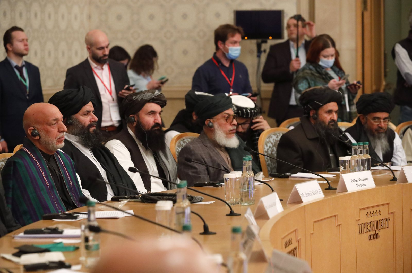 Former President Hamid Karzai (left) and Taliban co-founder Mullah Abdul Ghani Baradar (second right) attend an international peace conference in Moscow, Russia, March 18, 2021. (AP Photo)