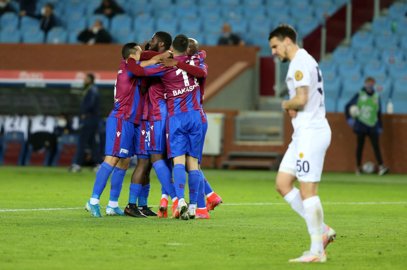 Trabzonspor players celebrate a goal against MKE Ankaragücü during a Turkish Süper Lig match in Trabzon, northern Turkey, March 20, 2021. (AA Photo)
