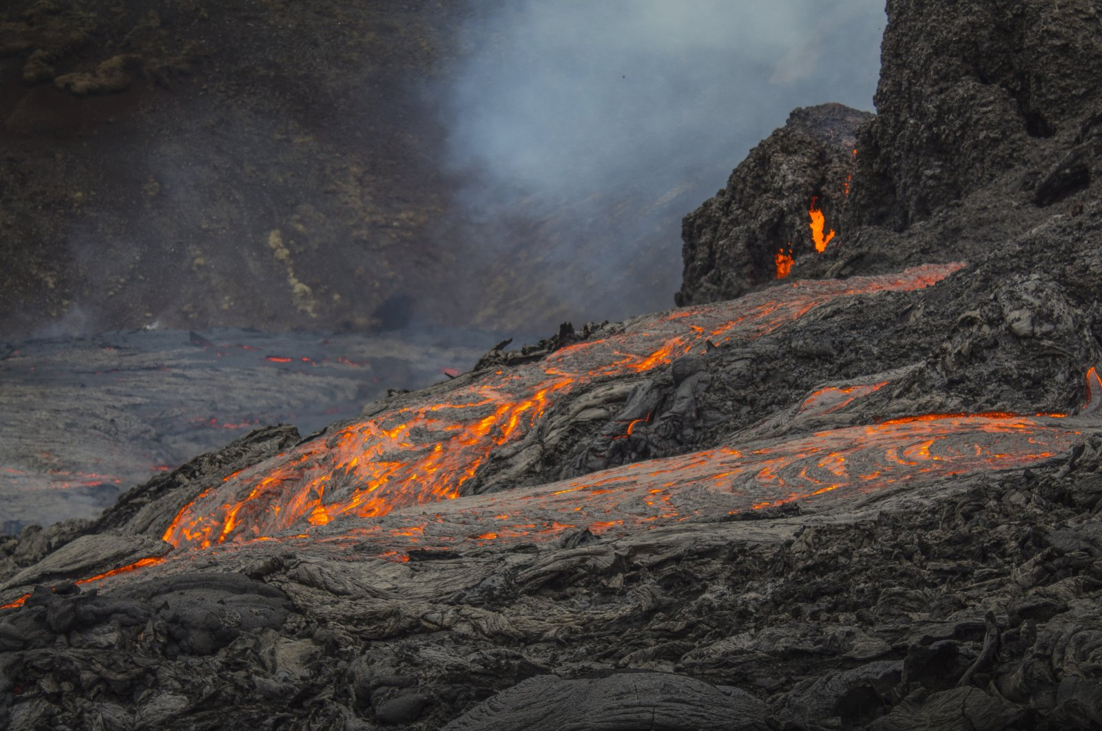 Lava flows from an eruption of a volcano on the Reykjanes Peninsula in southwestern Iceland, March 20, 2021. (AP Photo)