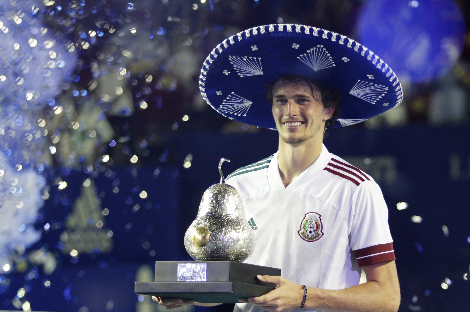 Germany's Alexander Zverev celebrates with the trophy after winning the Mexican Open at the Fairmont Acapulco Princess, Acapulco, Mexico, March 20, 2021. (Reuters Photo)