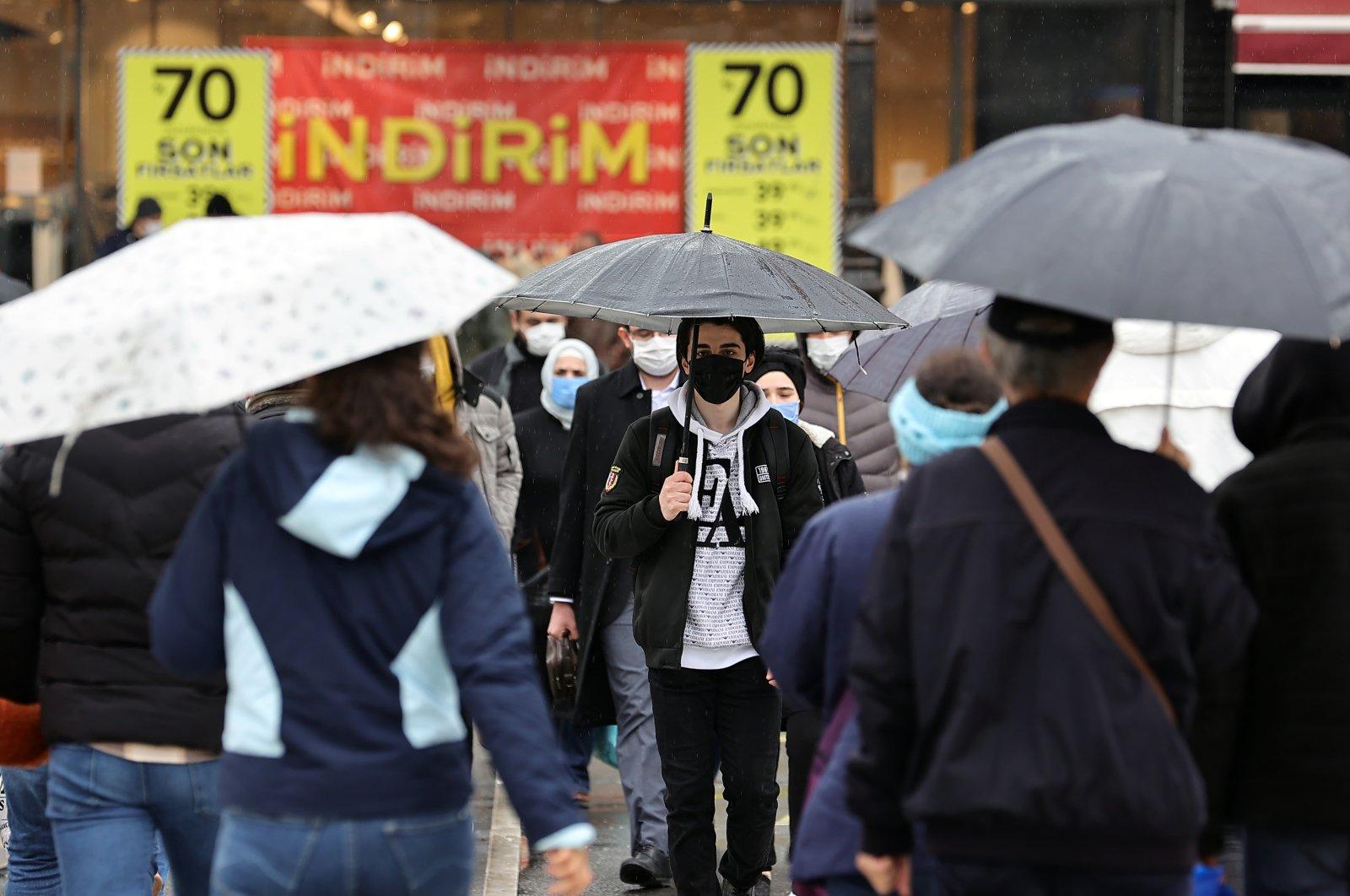 People with umbrellas walk in the rain in the capital, Ankara, Turkey, Mar. 20, 2021 (AA Photo)