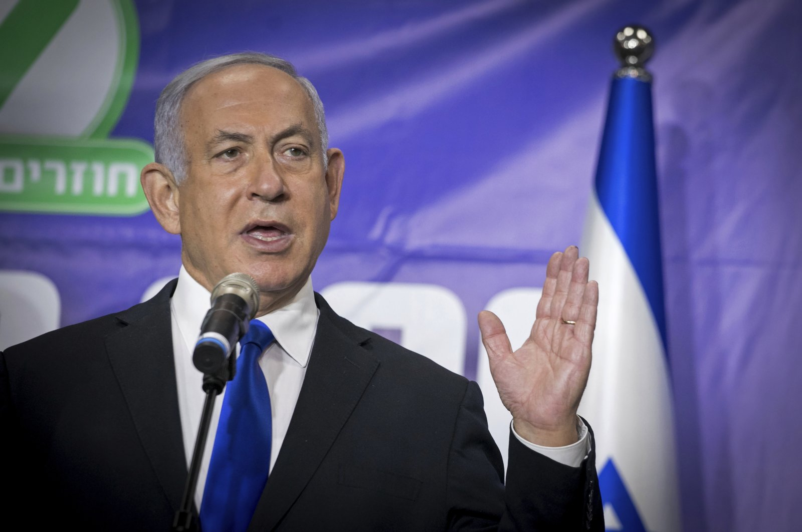 Israeli Prime Minister Benjamin Netanyahu speaks to journalists after meeting the Israeli citizen who was the 5 millionth person to be vaccinated in Israel, at a ceremony in Tel Aviv, Israel, March 8, 2021. (AP Photo)