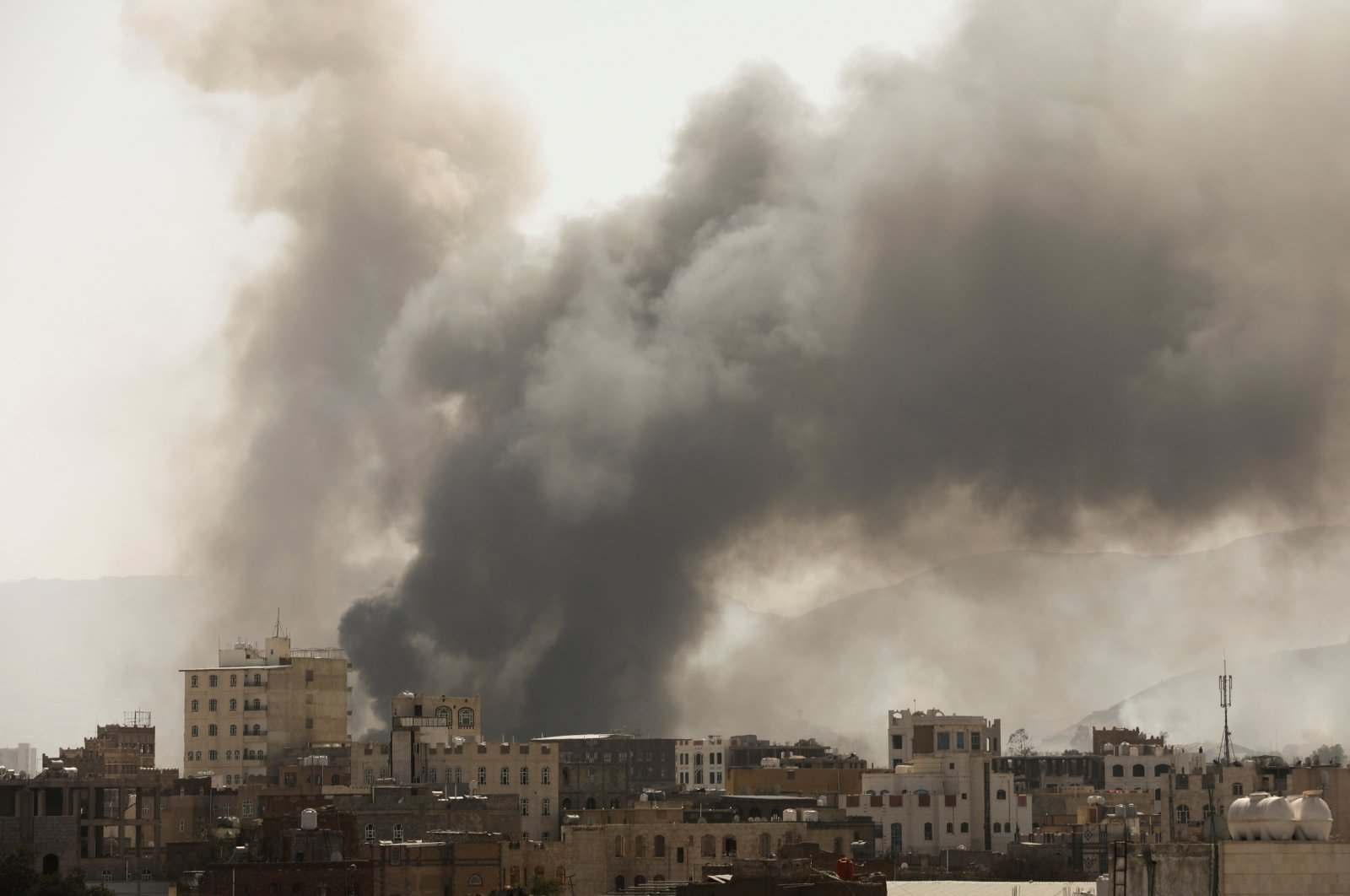 Smoke billows from the site of Saudi-led air strikes in Sanaa, Yemen March 7, 2021. (Reuters Photo)