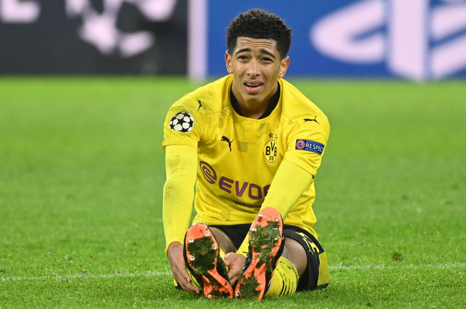 Dortmund's English midfielder Jude Bellingham sits on the pitch during the UEFA Champions League match against Lazio in Dortmund, western Germany, Dec. 02, 2020. (AFP Photo)