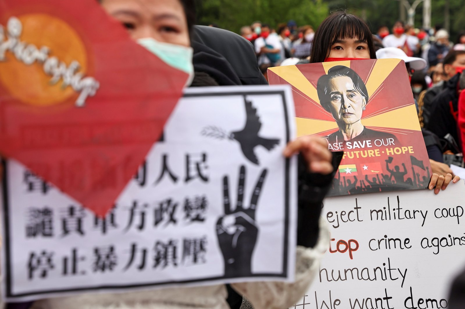 People hold placards as they gather to denounce the Myanmar military coup, in Taipei, Taiwan, March 21, 2021. (Reuters)