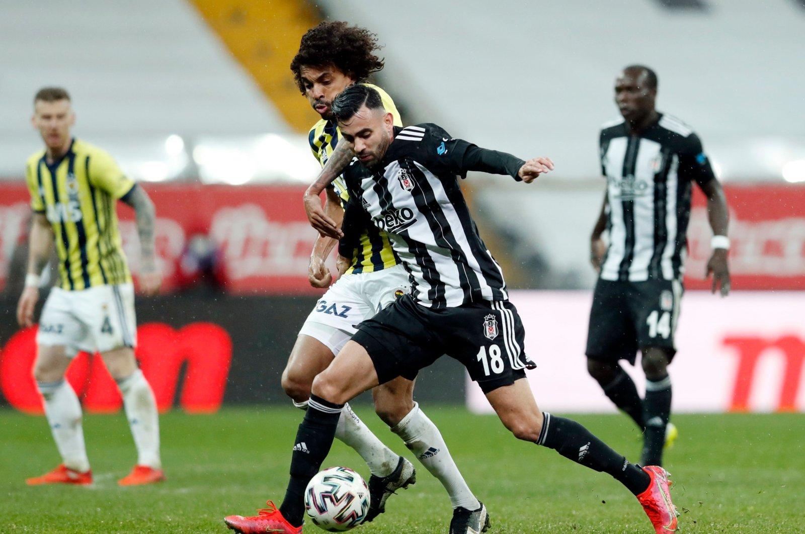 Beşiktaş's Rachid Ghezzal in action with Fenerbahçe's Luiz Gustavo on March 21, 2021. (Reuters Photo)