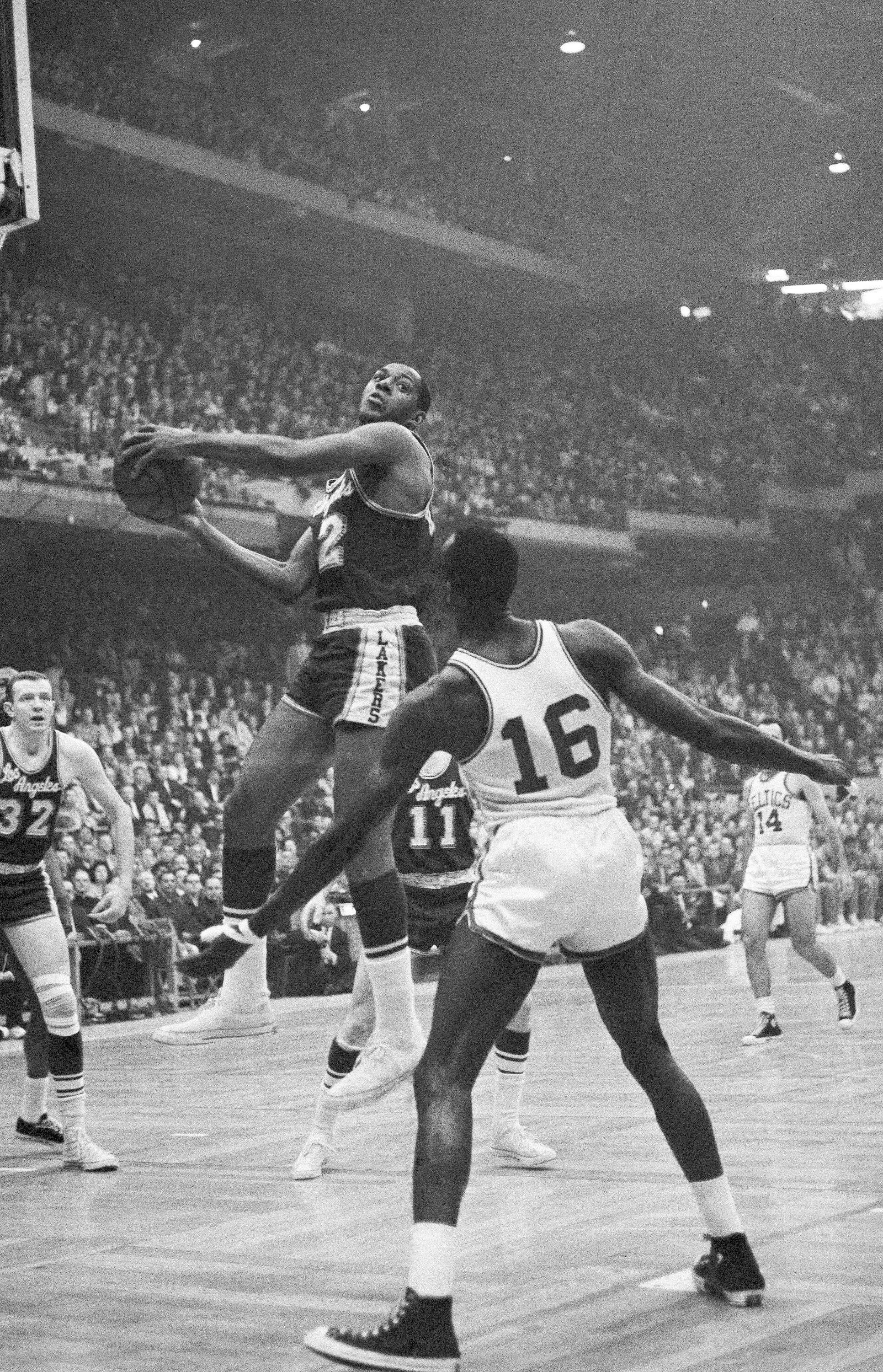 Los Angeles Lakers' Elgin Baylor (L) drives against the Boston Celtics during the NBA championship game in Boston, U.S., April 19, 1962. (AP Photo)