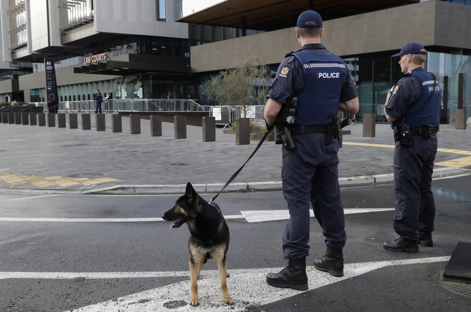 Police keep watch outside the Christchurch High Court ahead of day two of the sentencing hearing of Australian Brenton Harrison Tarrant, in Christchurch, New Zealand, Tuesday, Aug. 25, 2020. (AP Photo)
