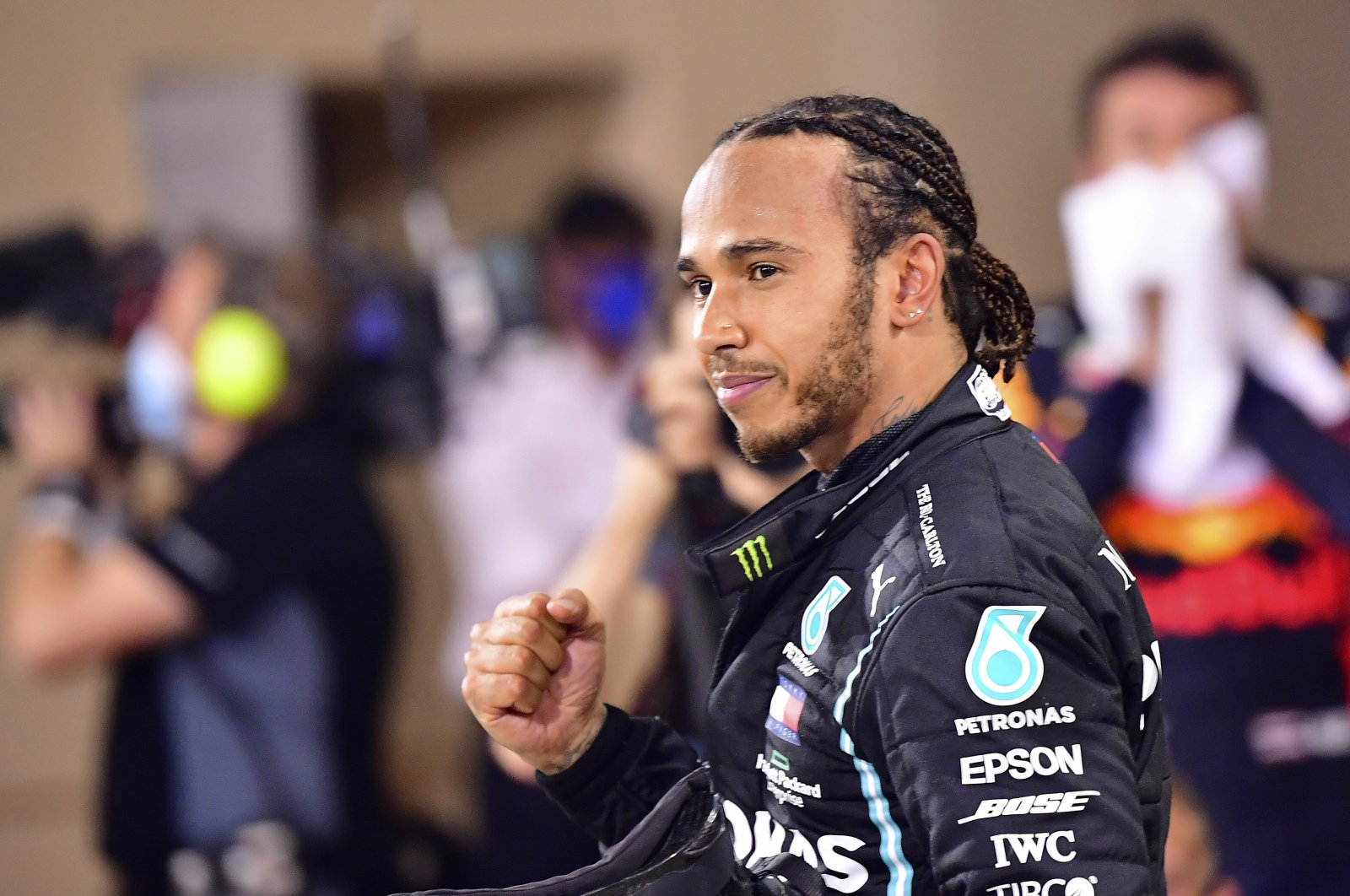 Mercedes driver Lewis Hamilton celebrates winning the Formula One race in Bahrain International Circuit in Sakhir, Bahrain, Nov. 29, 2020. (AP Photo)
