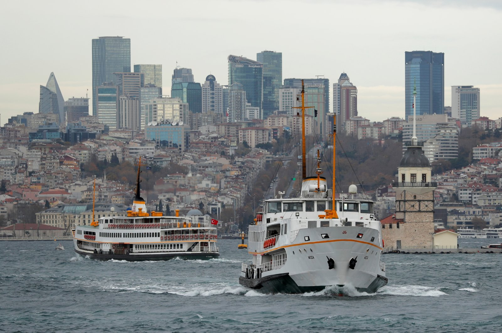 Ferries, with the city's skyscrapers in the background, sail in the Bosphorus in Istanbul, Turkey, Dec. 11, 2020. (Reuters Photo)