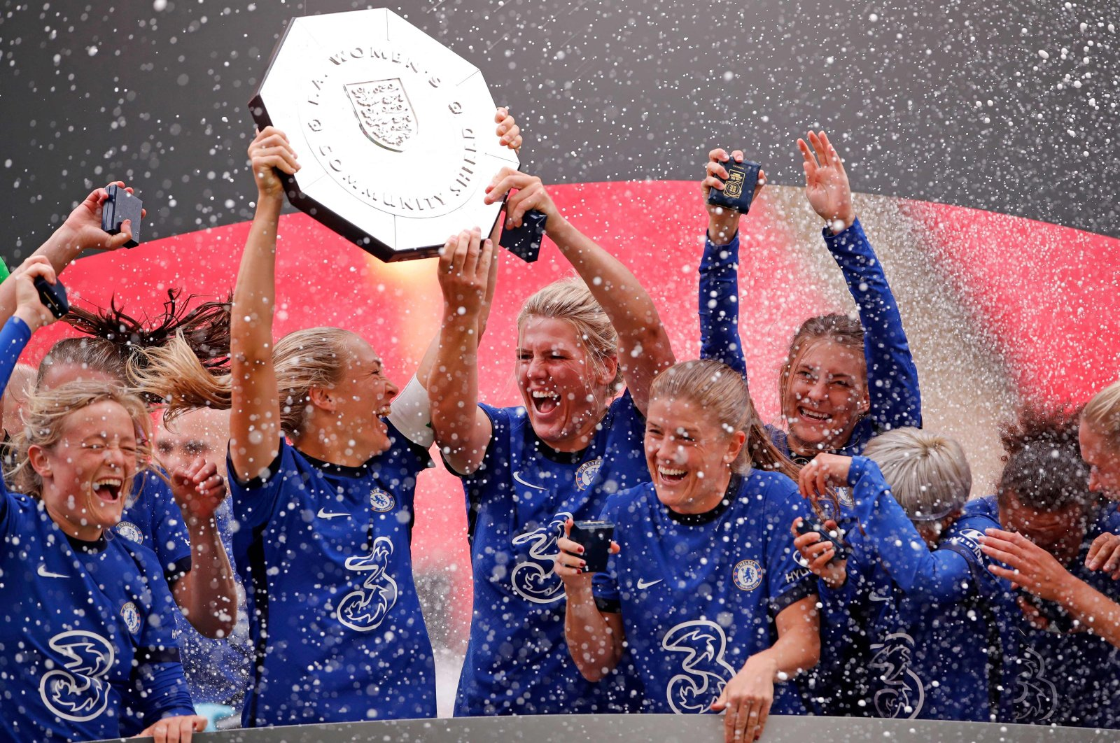 Chelsea's captain Magdalena Eriksson and English defender Millie Bright lift the English FA Women's Community Shield trophy at Wembley Stadium, London, Britain, Aug. 29, 2020. (AFP Photo)