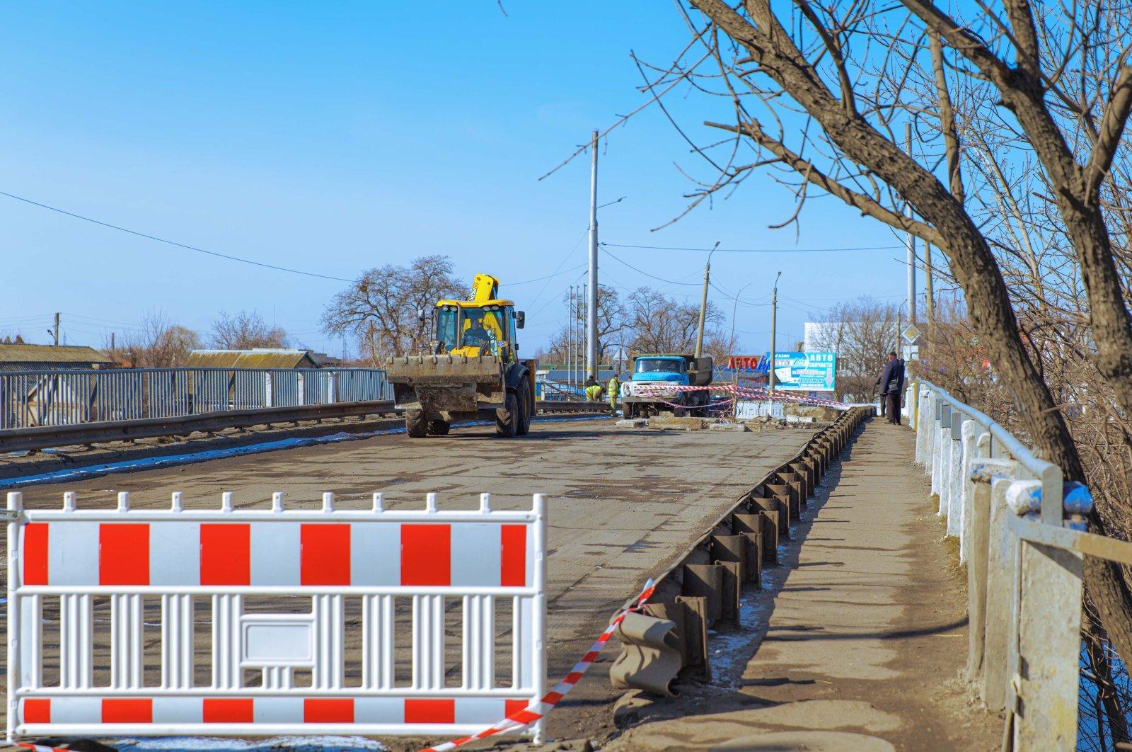 Renovation work is carried out on a bridge in Sloviansk, Ukraine, March 10, 2021. (Shutterstock Photo)