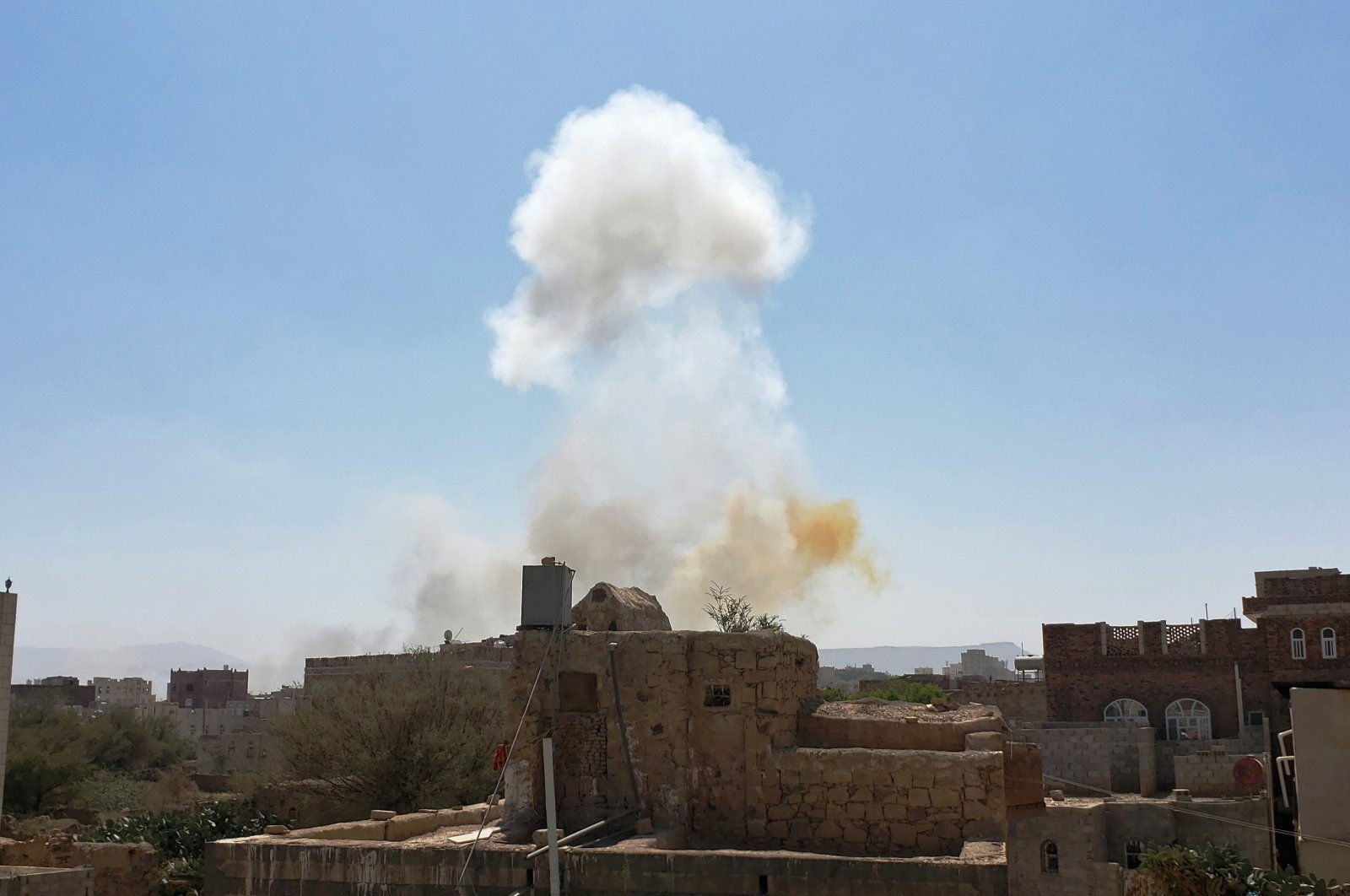 In this Mar. 7, 2021 file photo, smoke rises after Saudi-led airstrikes on an army base in Sanaa, Yemen. (AP Photo)