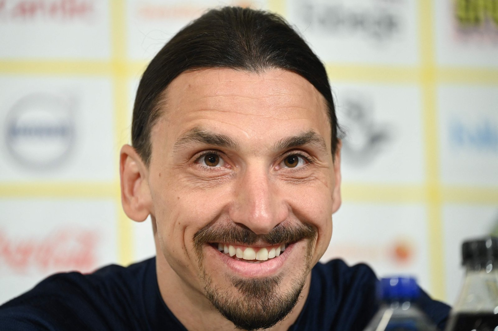 Sweden's forward Zlatan Ibrahimovic smiles as he addresses a press conference prior to the World Cup qualifier of Sweden vs Georgia match, Stockholm, Sweden, March 22, 2021. (AFP Photo)