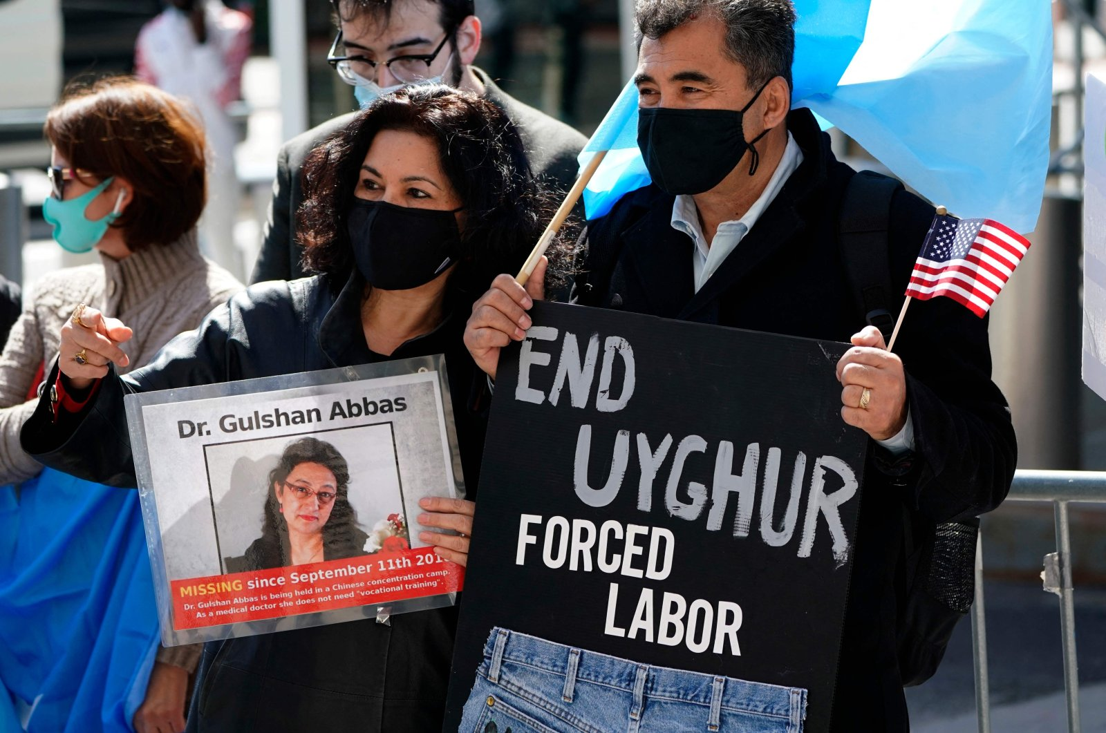 Protestors hold signs as they gather during a rally for Uyghur Freedom in New York City on March 22, 2021. (AFP Photo)