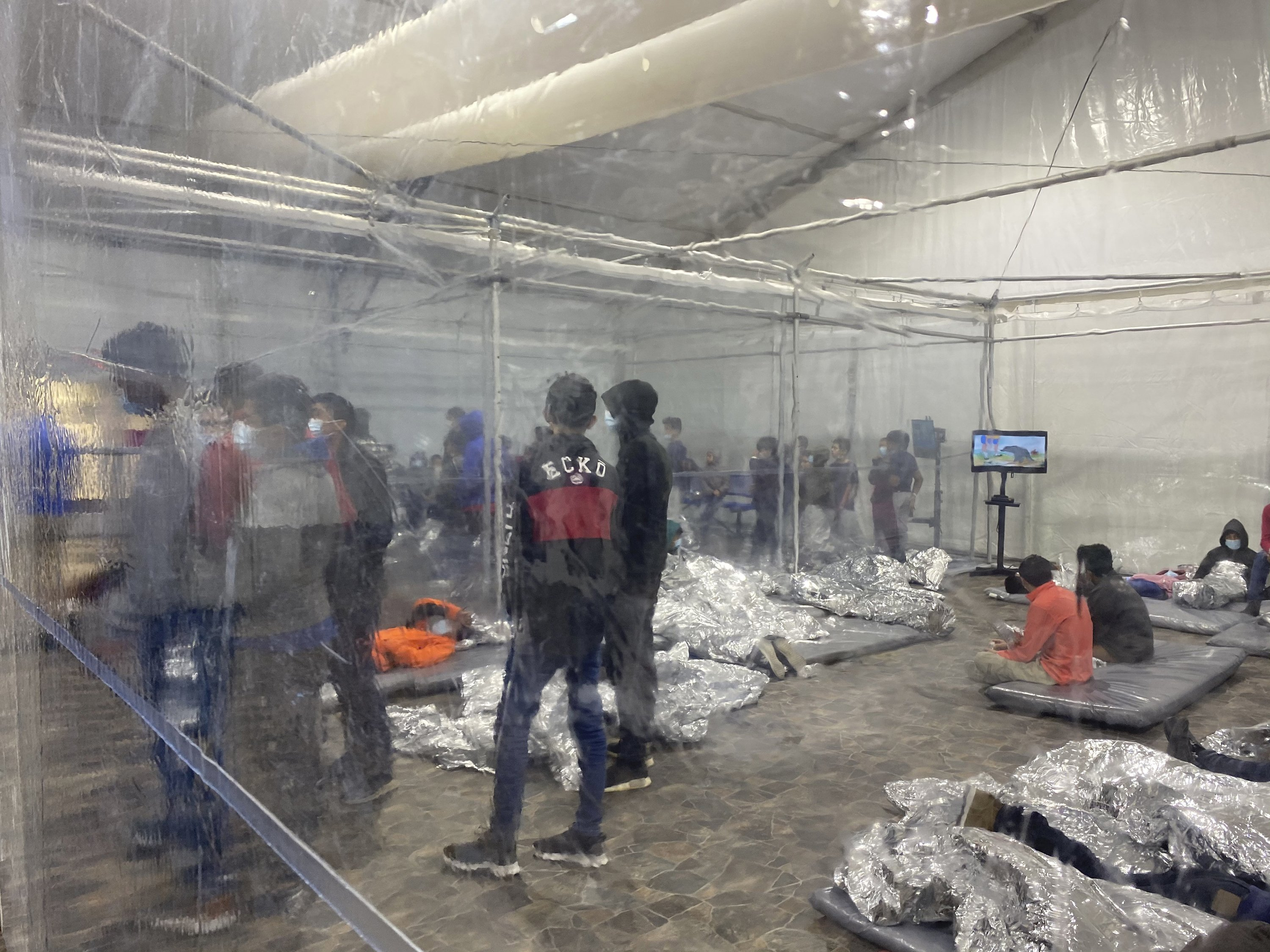Detainees in a Customs and Border Protection (CBP) temporary overflow facility in Donna, Texas, U.S., March 20, 2021.  (Photo courtesy of the Office of Congressman Henry Cuellar via AP)