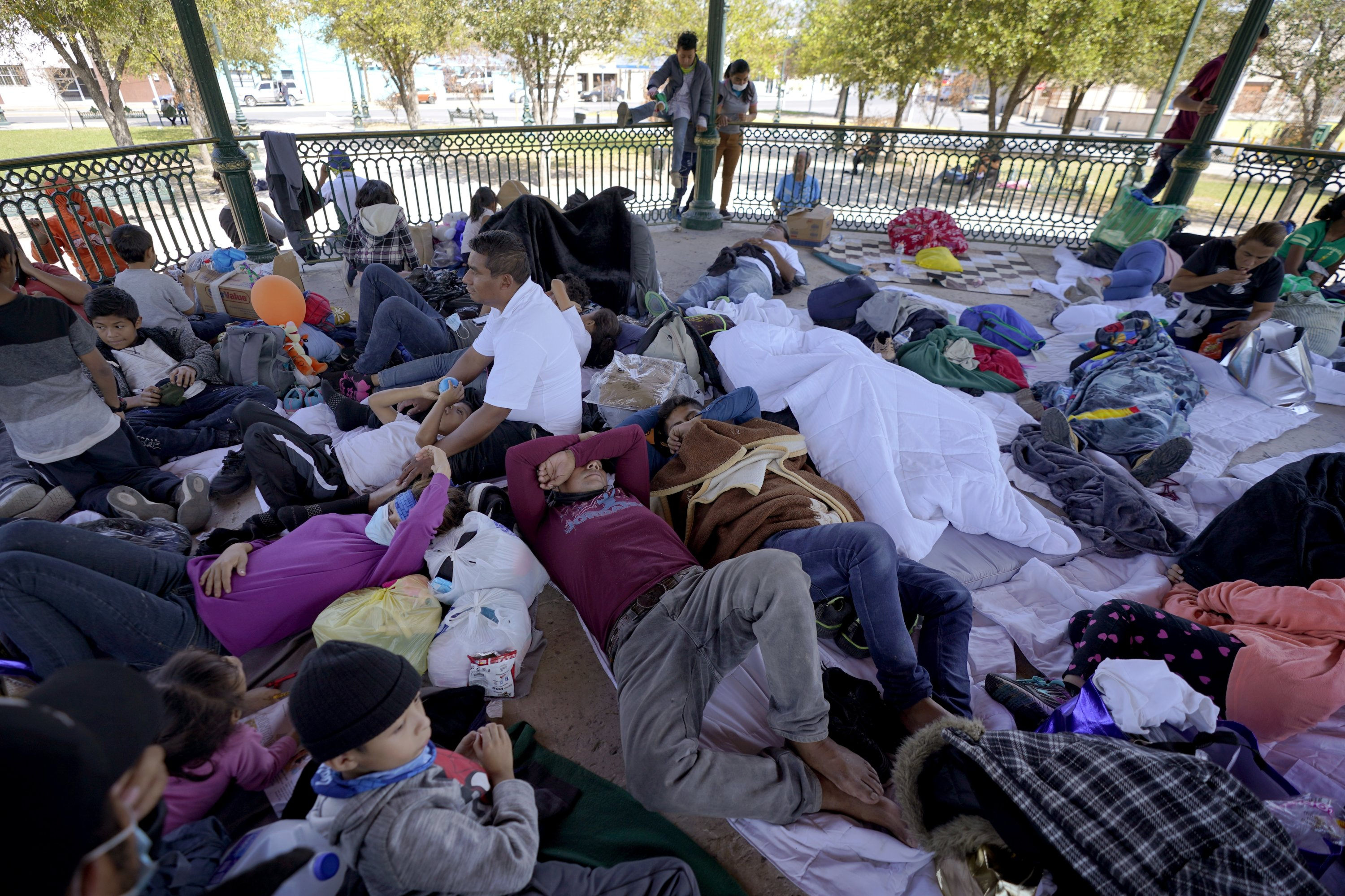 A group of migrants rests on a gazebo at a park after they were expelled from the U.S. and pushed by Mexican authorities off an area where they had been staying, in Reynosa, Mexico, March 20, 2021. (AP Photo/Julio Cortez)