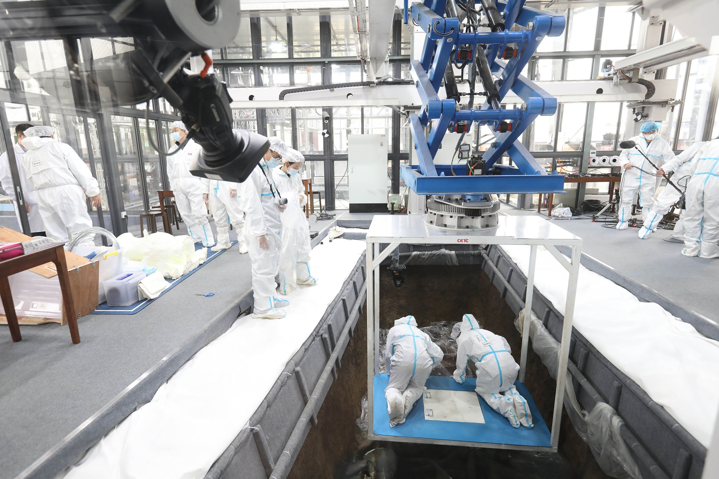 Archaeologists work at the No. 3 sacrificial pit of the Sanxingdui Ruins site in Deyang, Sichuan province, China, March 20, 2021. (Getty Images)